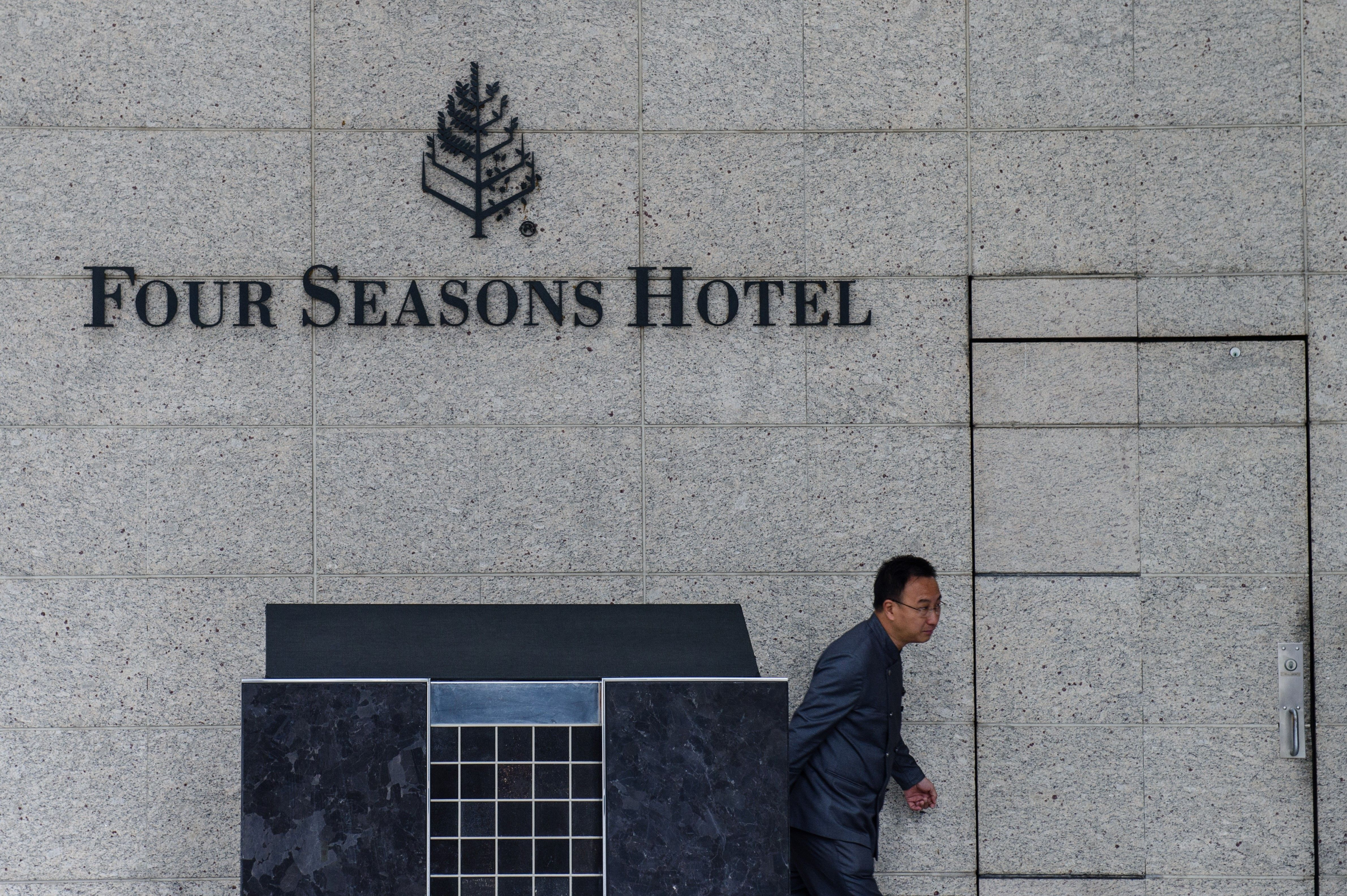 A member of staff walks outside the Four Seasons Hotel in Hong Kong on Feb. 1, 2017.