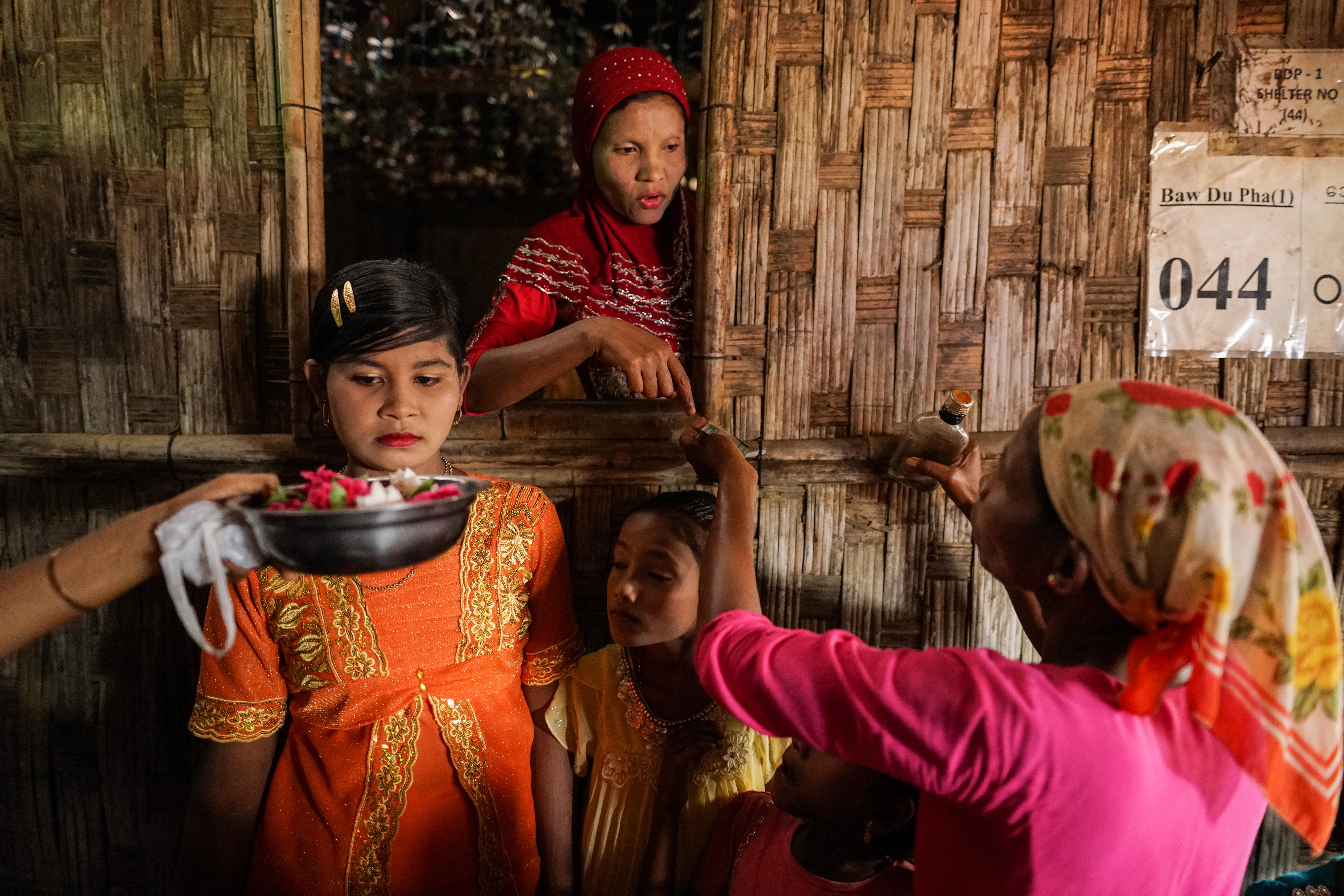 Friends and relatives prepare for a wedding at the Baw Du Pha Rohingya displacement camp in Rakhine state, Myanmar, on March 12, 2017