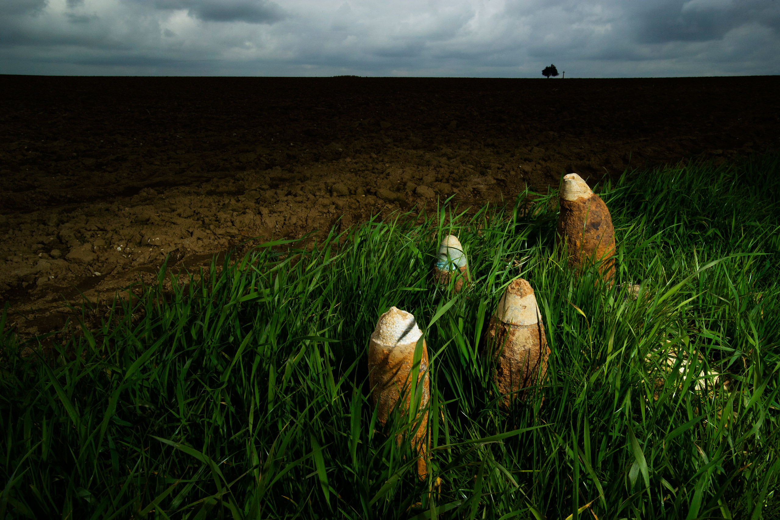 Unexploded shells uncovered by ploughing near Munich Trench Cemetery awaiting collection by the Bomb Squad.