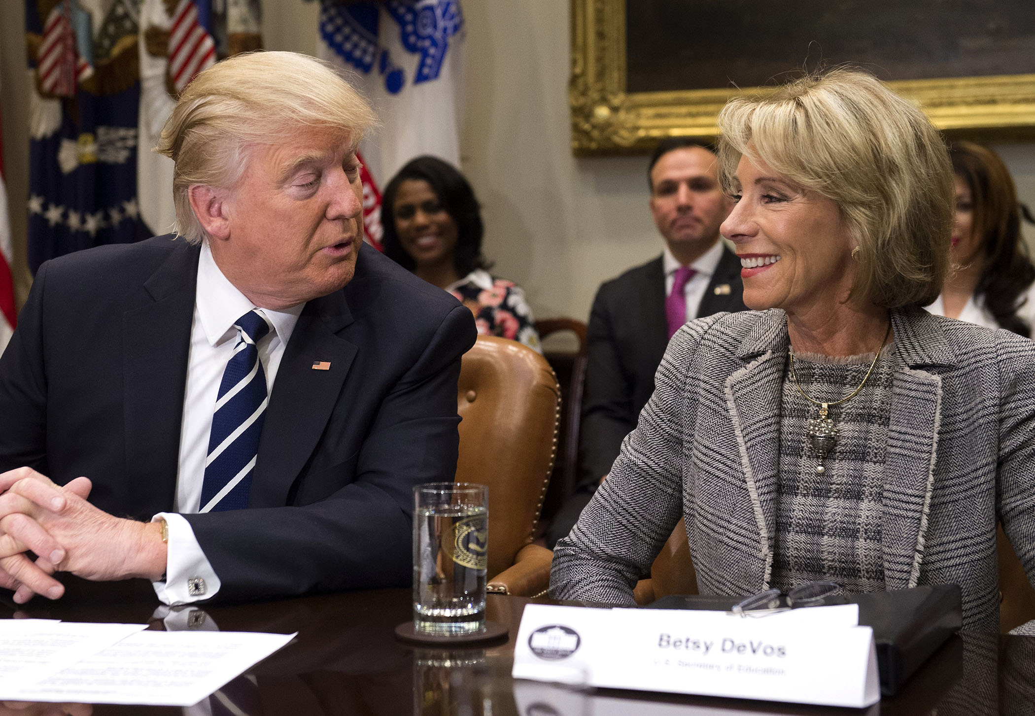 US President Donald Trump and Secretary of Education Betsy DeVos attend a meeting with teachers, school administrators and parents in the Roosevelt Room of the White House in Washington, DC, February 14, 2017.