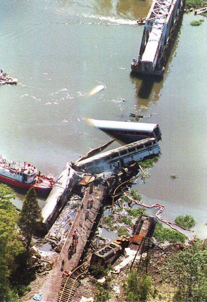 MOBILE, AL - SEPTEMBER 22: A portion the Sunset Limited, an Amtrak express train running from Los Angeles to Miami, lies partially submerged in a bayou about eight miles north of the city of Mobile, Alabama, 22 September 1993.