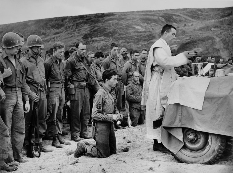 FRANCE. Normandy. June, 1944. A Catholic Priest conducts mass on Omaha Beach.