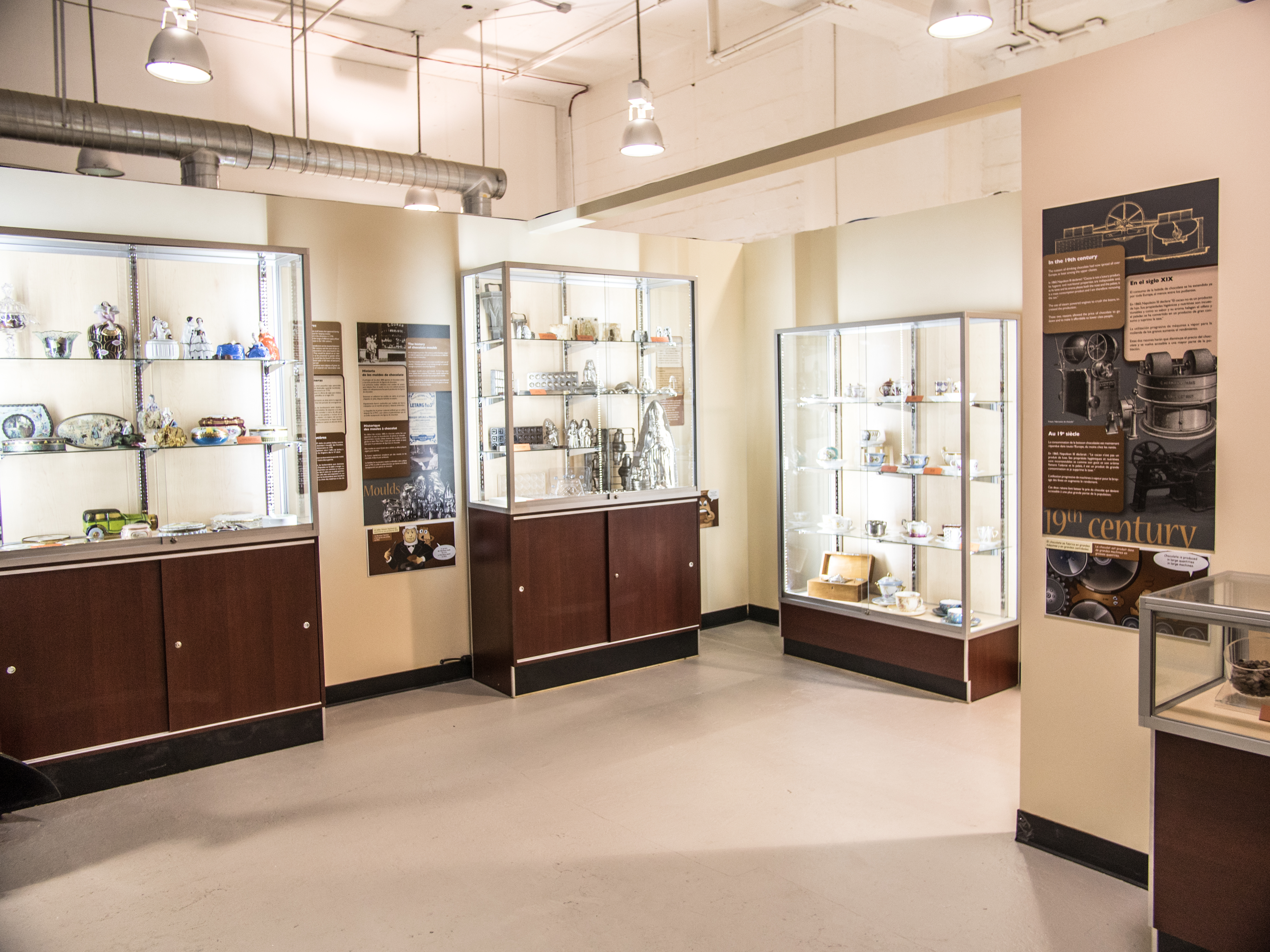 Curated display cases include historical artifacts that trace the history of cocoa and chocolate.