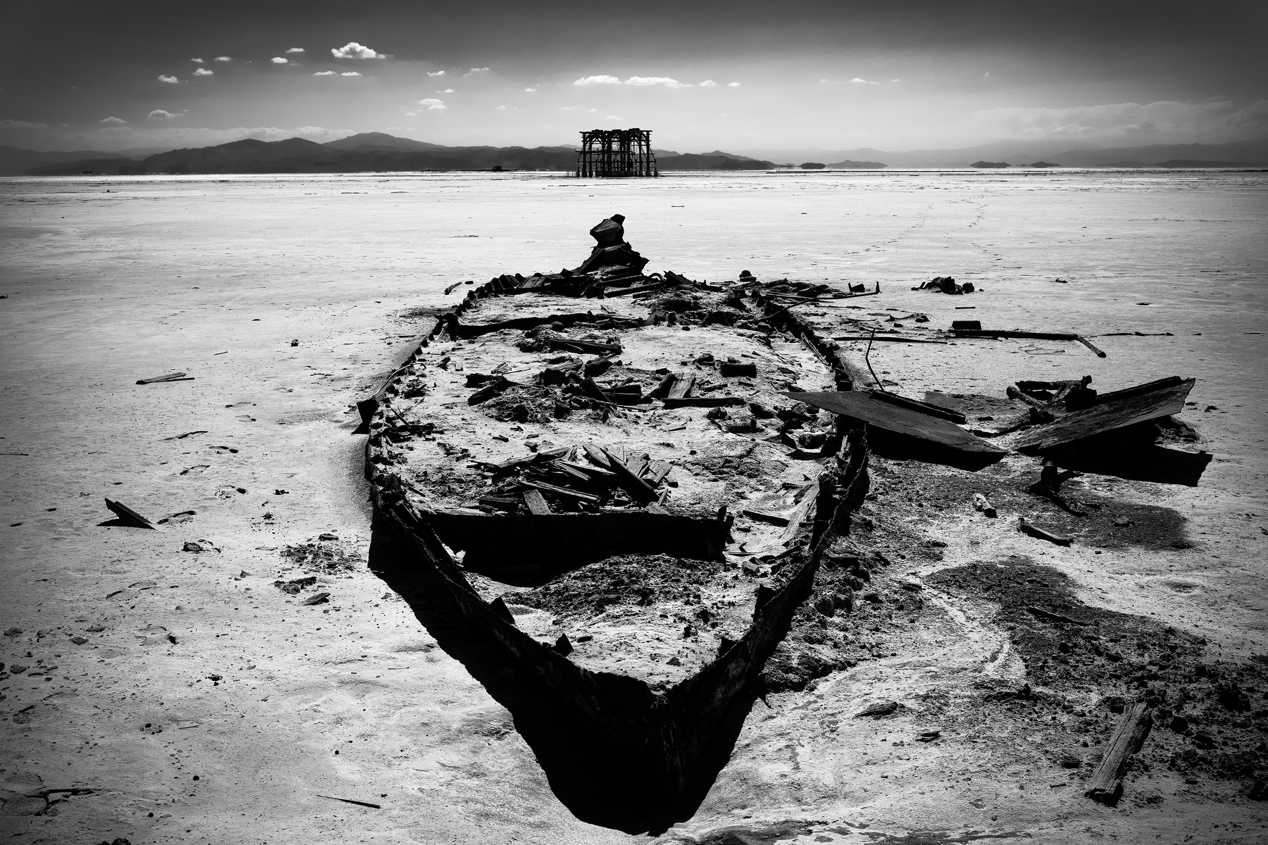 The remains of a boat on the dried-out seabed of Lake Urmia, the port of Sharafghaneh, Iran, July 2016. Drought has impacted tourism to the city.