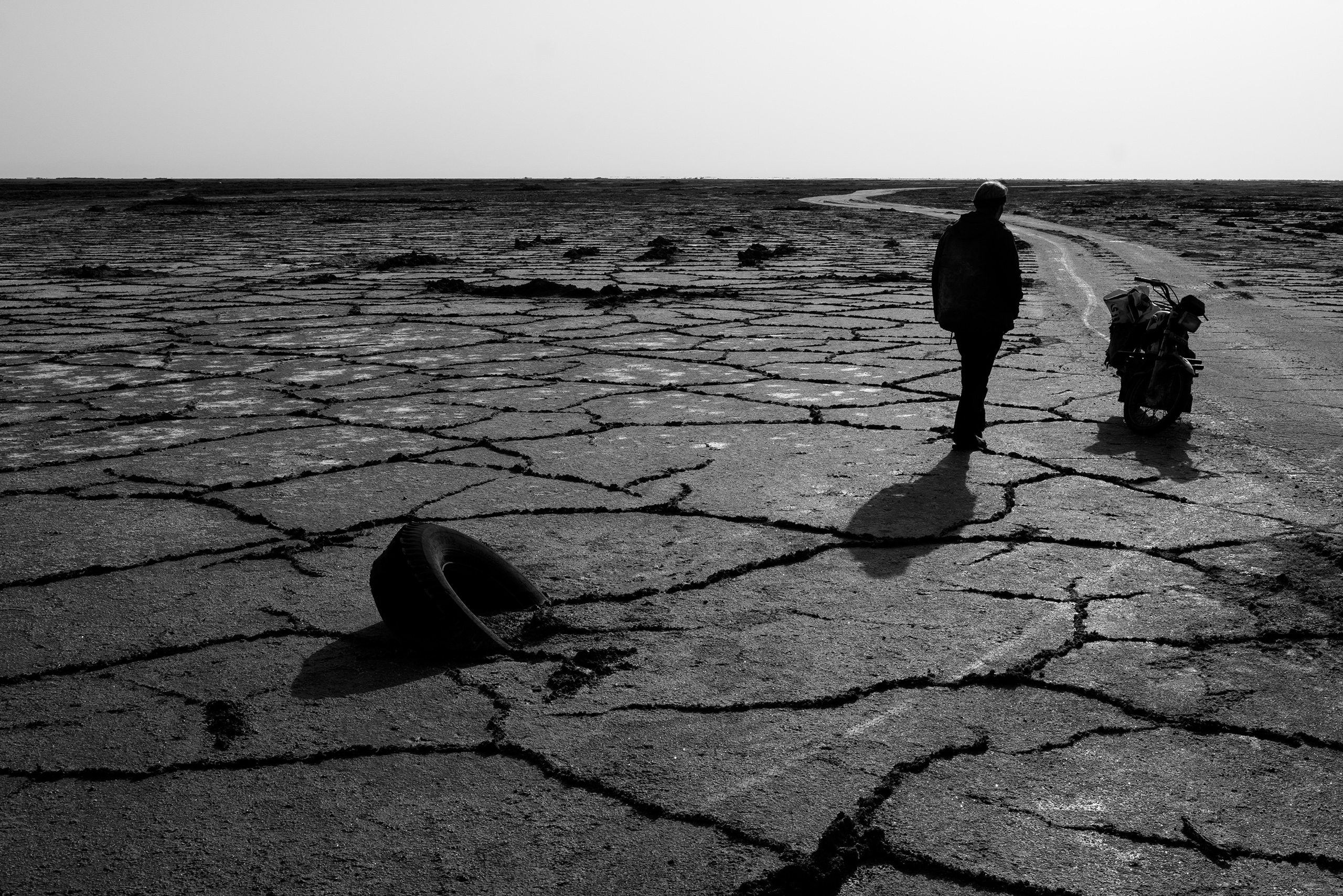 Cracked land of the Gavkhouni salt marsh, the terminal basin of the Zayandeh River in Isfahan Province, Iran. Droughts and water mismanagement have contributed to Iran's water crisis, May 2016.