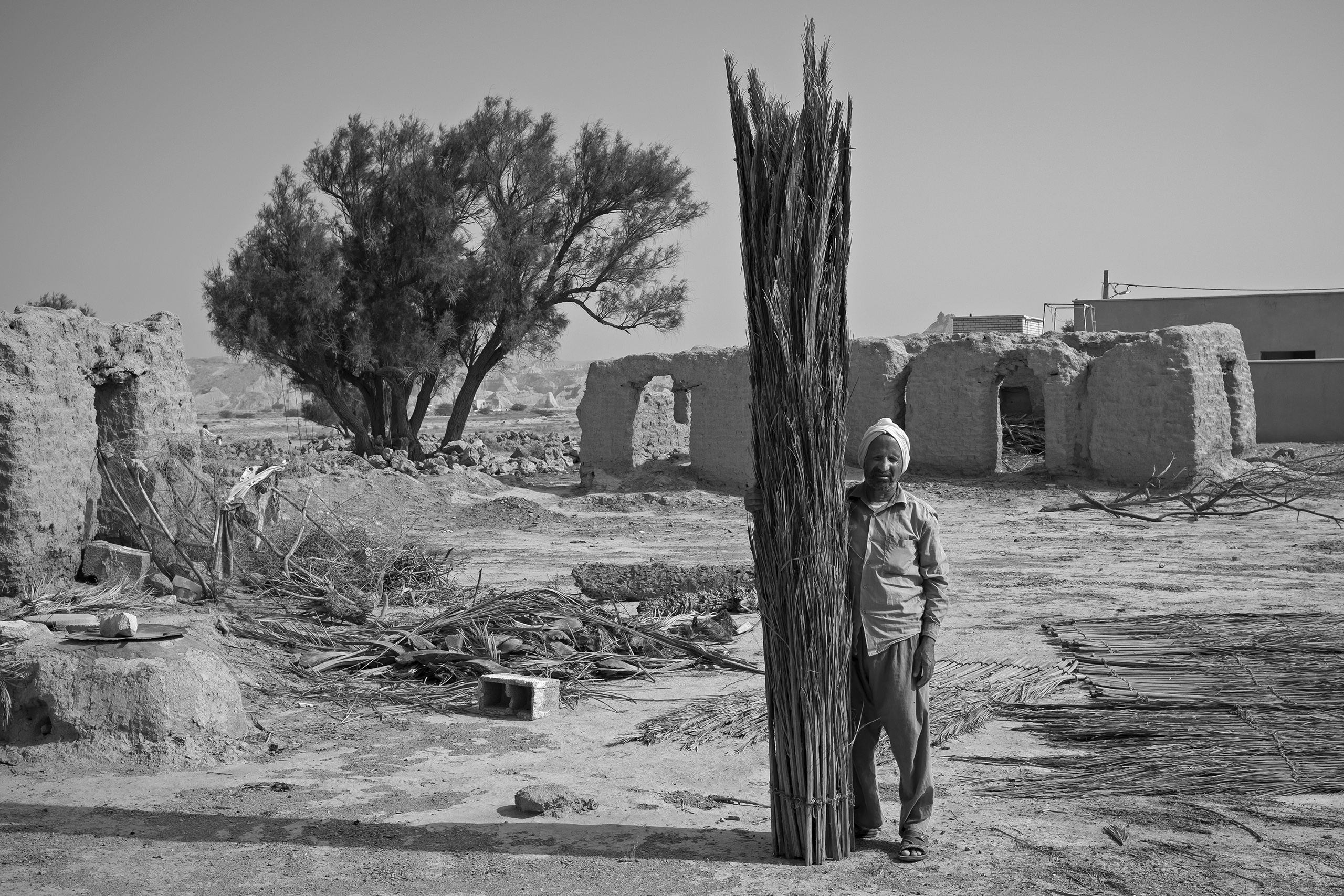 A straw weaver stands in his empty village in the coastal Persian Gulf,   we had underground fresh water 40 years ago both for drinking and agriculture, but have nothing now,  he said. Over recent years, temperatures have risen and there is a lack of fresh water, forcing many to leave their homes, May, 2016,