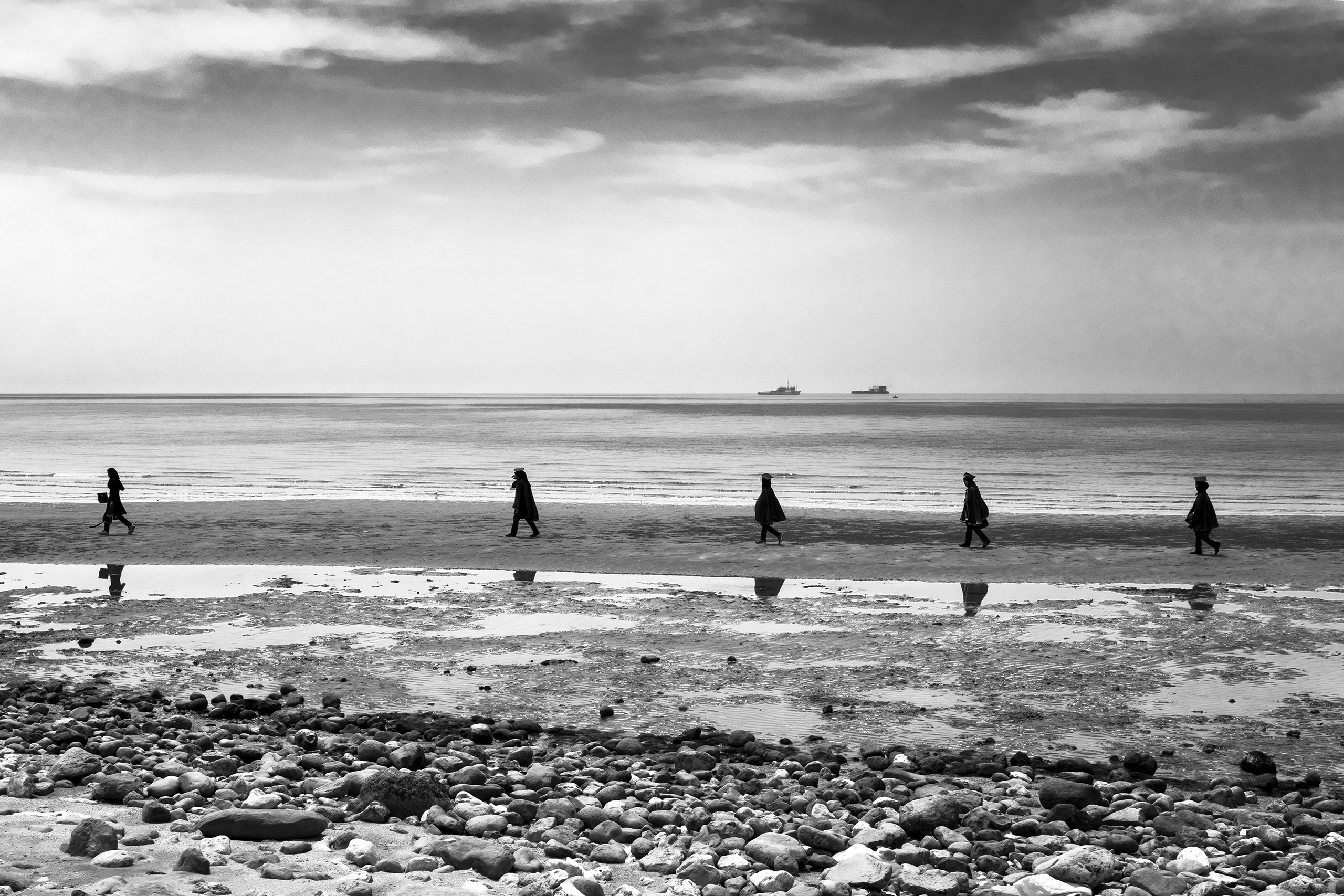 Students walk by the seaside in Dayyer, Persian Gulf, Iran, where two months earlier, there was severe flooding. Iran's coastline is in danger of  rising seas, May 2016.