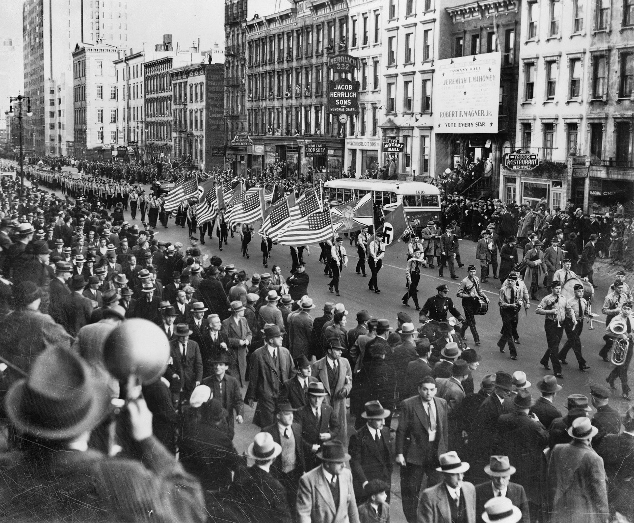 American Nazis parade on East 86th St. in New York City around 1939.