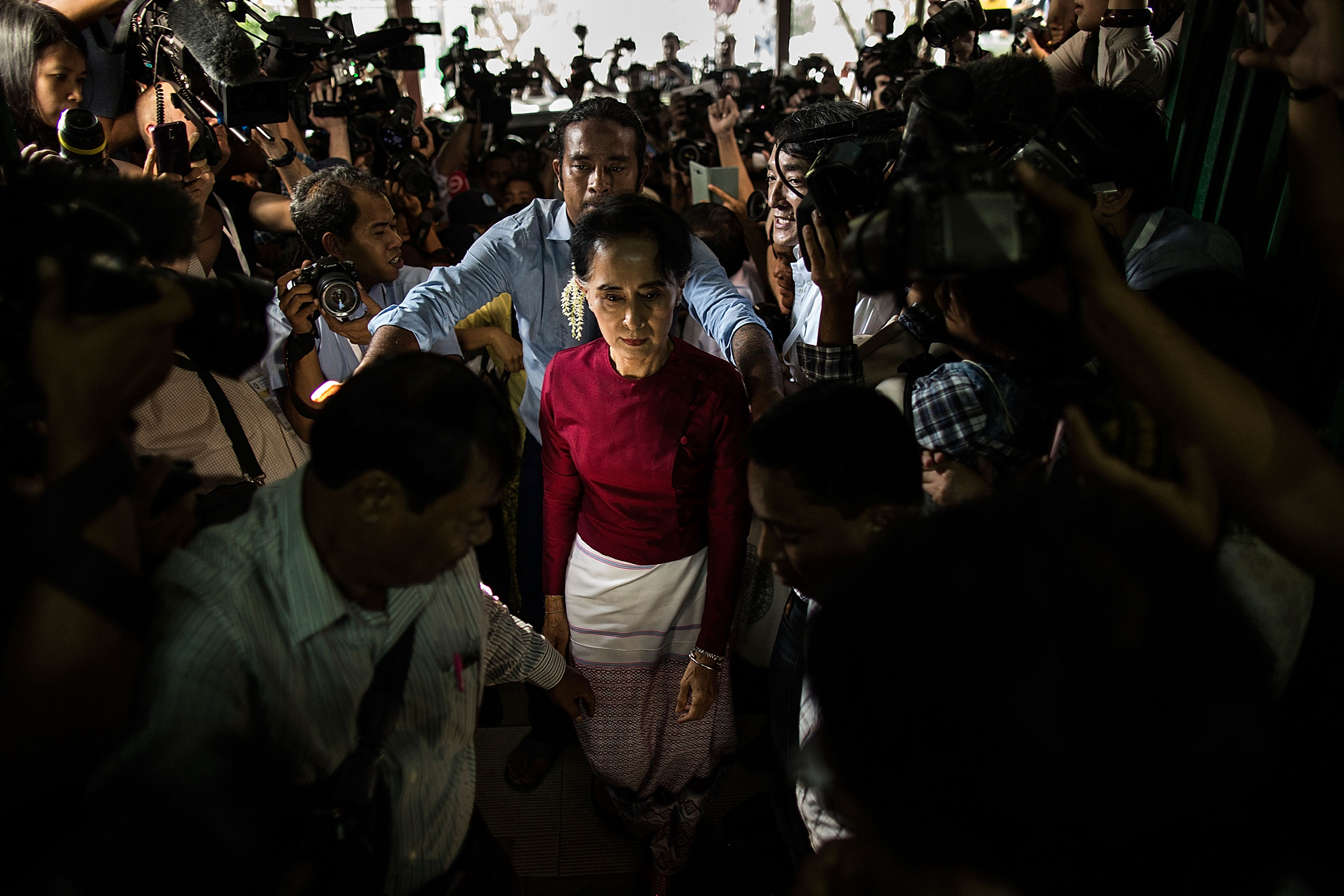 Aung San Suu Kyi arrives at the polling station to cast her vote during Myanmar's first free election in a quarter-century in Yangon, Myanmar, on Nov. 8, 2015
