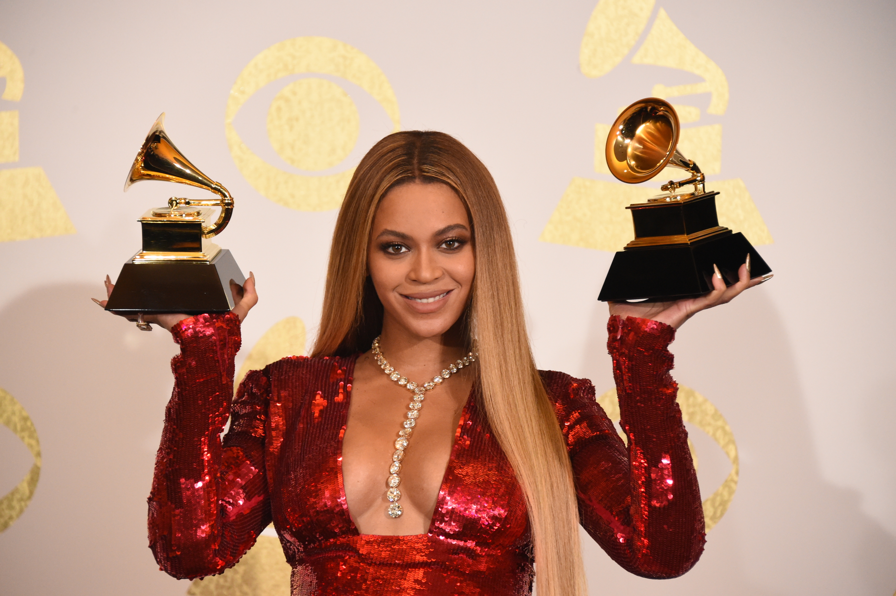 Beyoncé poses for photographs backstage at THE 59TH ANNUAL GRAMMY AWARDS.