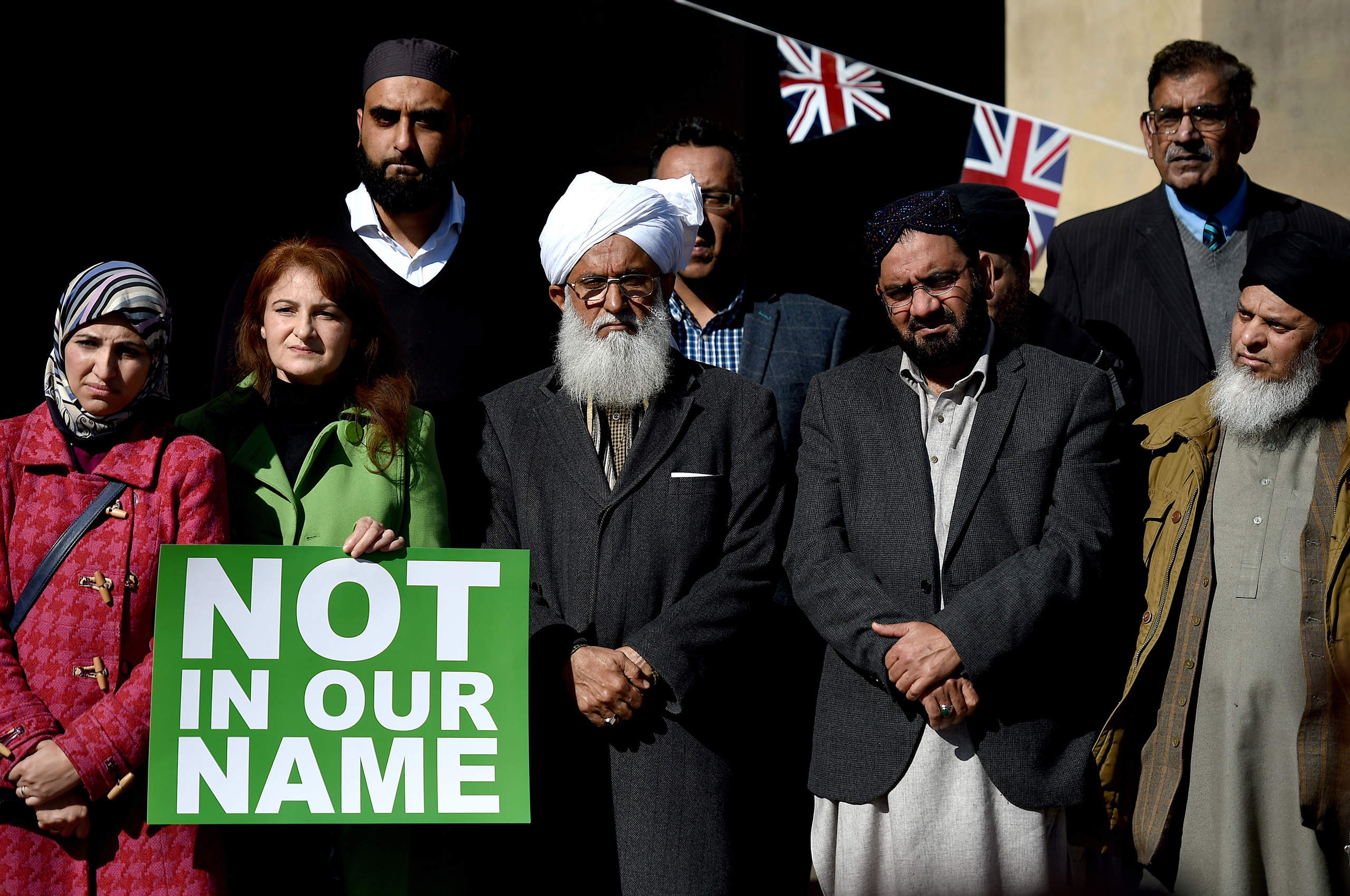 People take part in a #NotInOurName public rally against terrorism organized by members of the Muslim community in Victoria Square, Birmingham, on March 25, 2017.