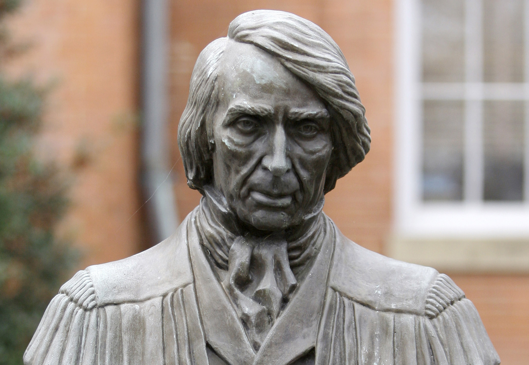 A statue of Supreme Court Chief Justice Roger Brooke Taney is displayed in front of City Hall, in Frederick, Md.