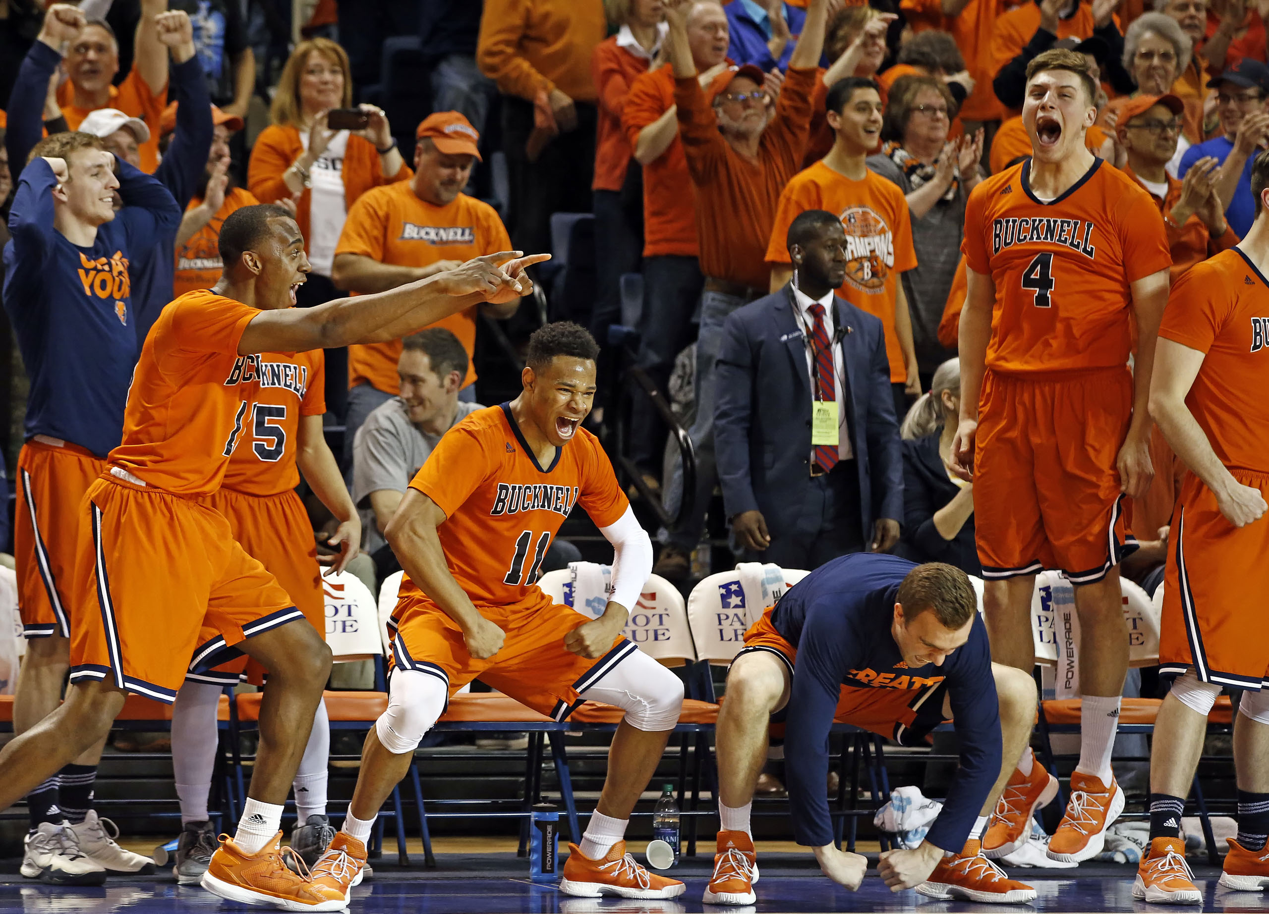 Players on the Bucknell bench celebrate at the end of the team's NCAA college basketball game against Lehigh for the Patriot League tournament championship in Lewisburg, Pa., on March 8, 2017. Bucknell won 81-65.
