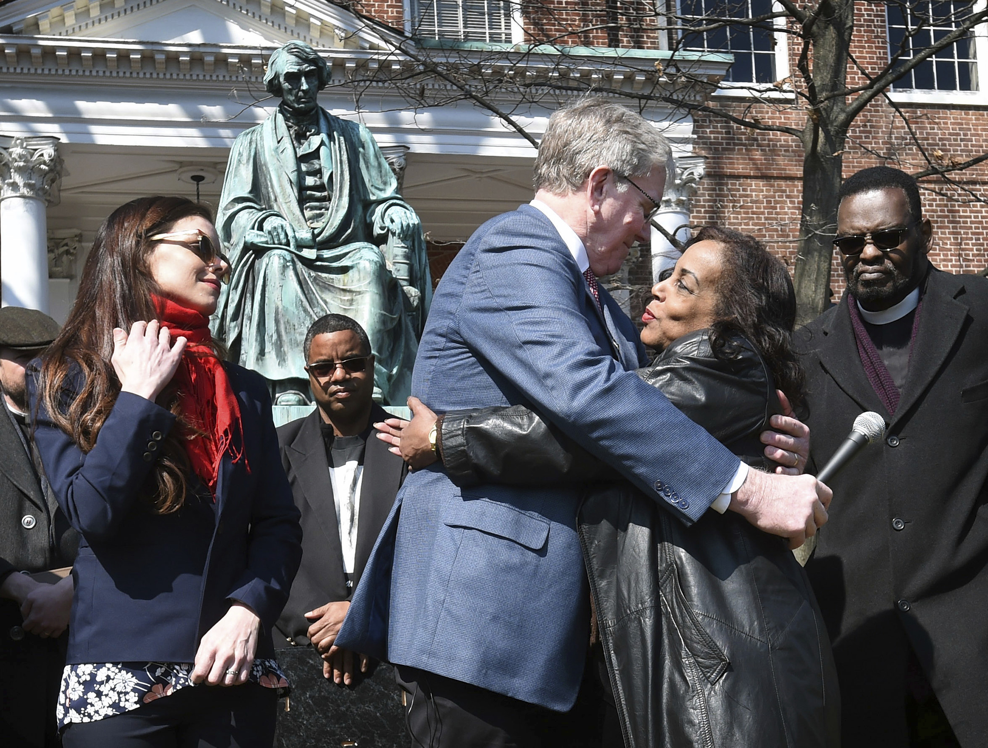 Lynne Jackson (R), a descendant of Dred Scott, hugs Charles Taney III, a descendant of U.S. Supreme Court Chief Justice Roger Taney, on the 160th anniversary of the Dred Scott decision in front of the Maryland State House on March 6, 2017, in Annapolis, Md.