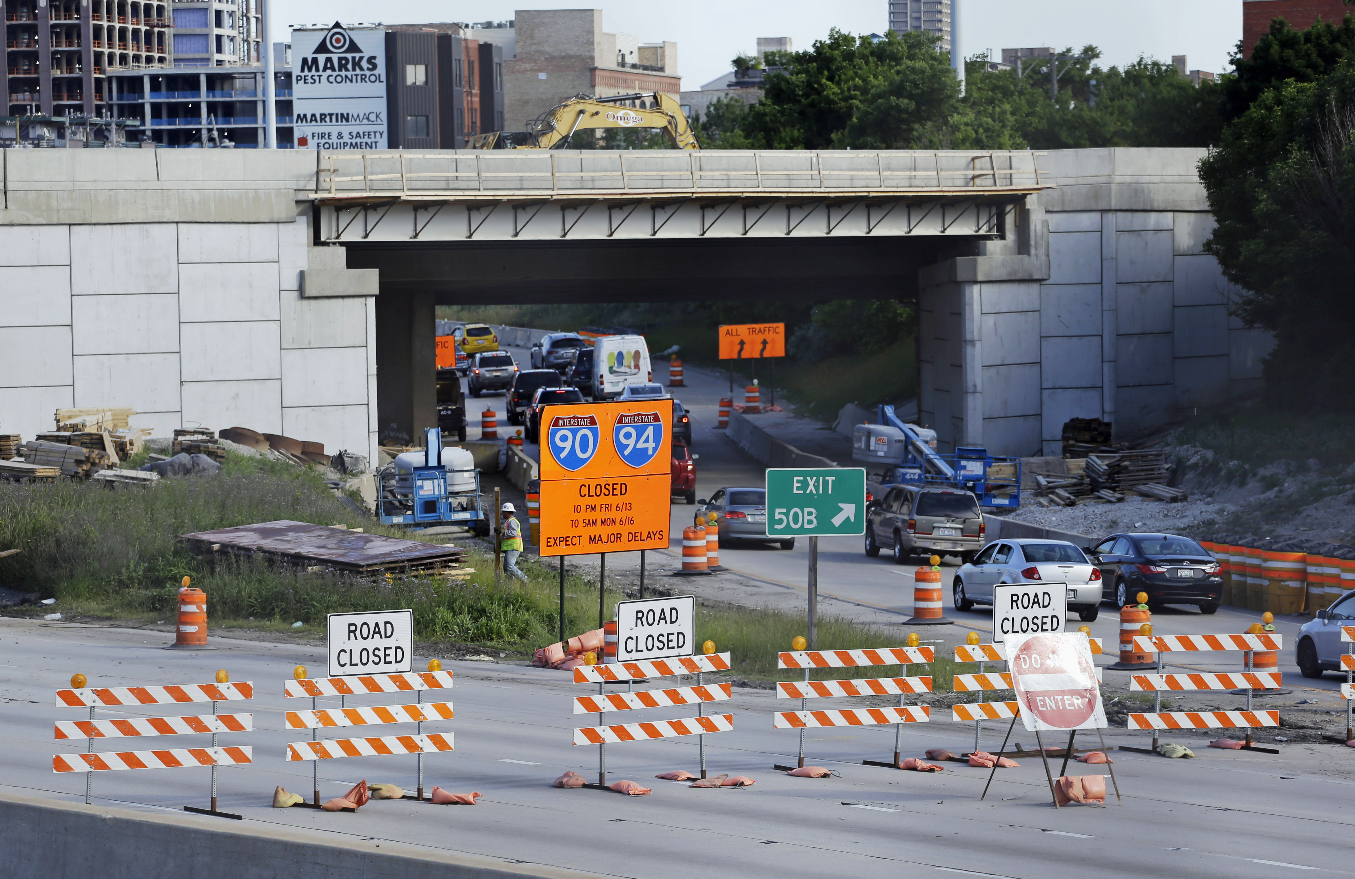 In this June 14, 2014 file photo, inbound Kennedy Expressway traffic is diverted onto the Ohio Street off ramp at a road construction project in Chicago