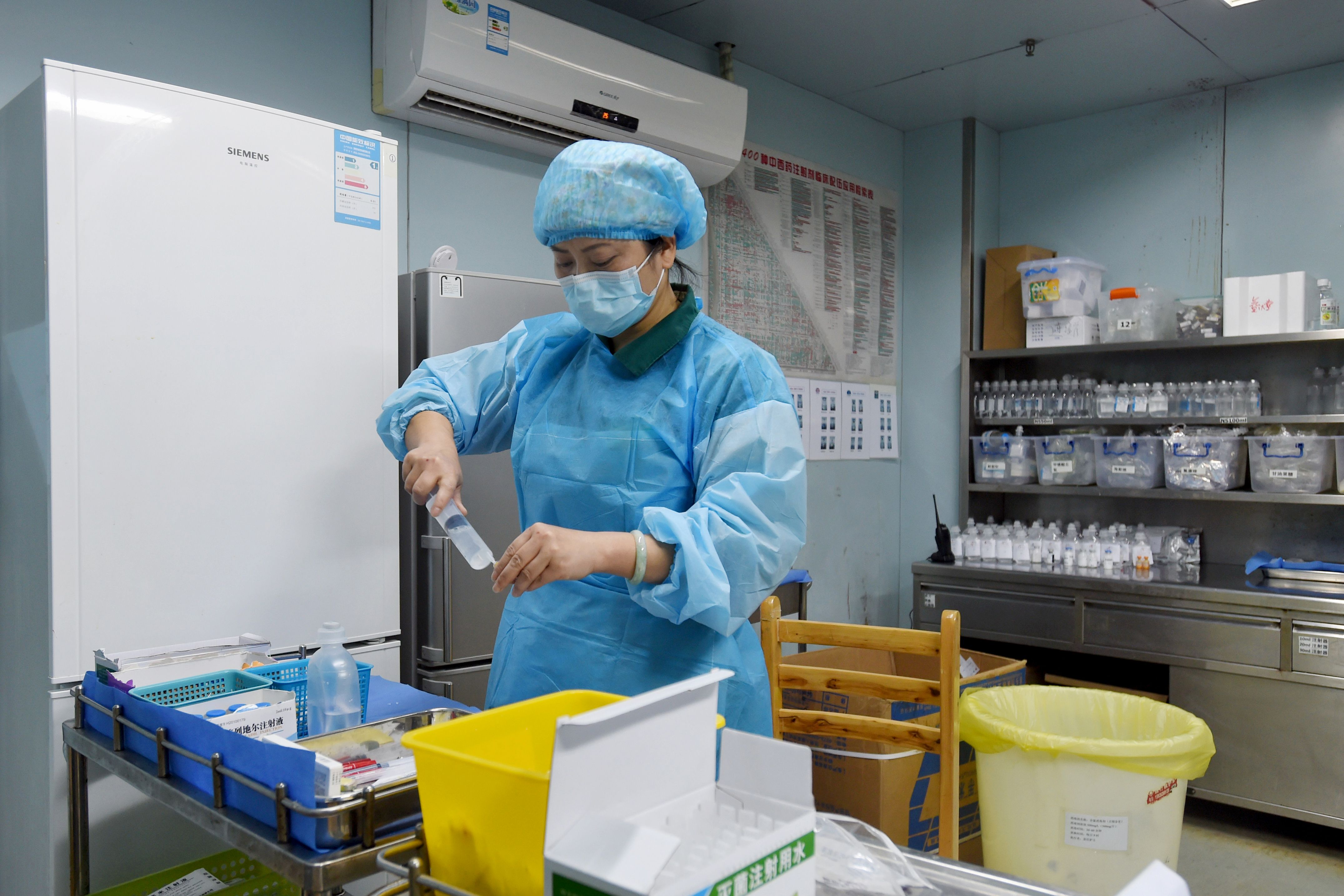 A nurse prepares medication for an H7N9 bird flu patient in a hospital in Wuhan, central China's Hubei province on Feb. 12.