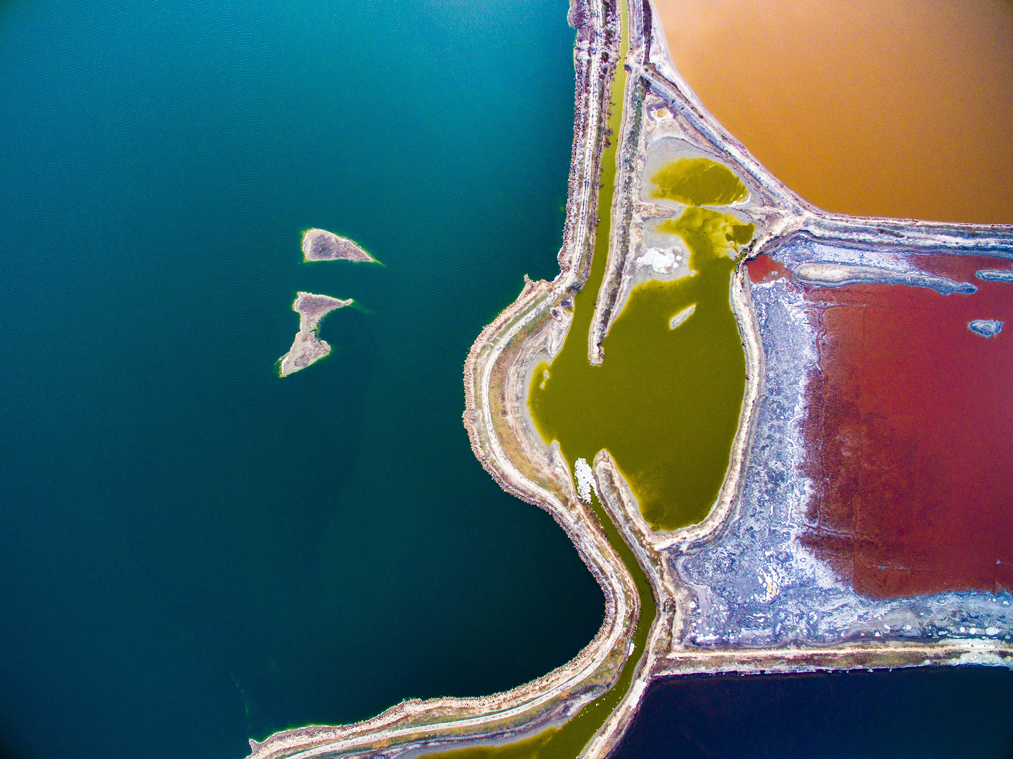 An aerial view of a world-renowned inland salt lake known as the  Dead Sea of China  in Yuncheng, Shanxi Province, on March 20, 2017. As temperature rises in the spring, the color of Salt Lake changes.