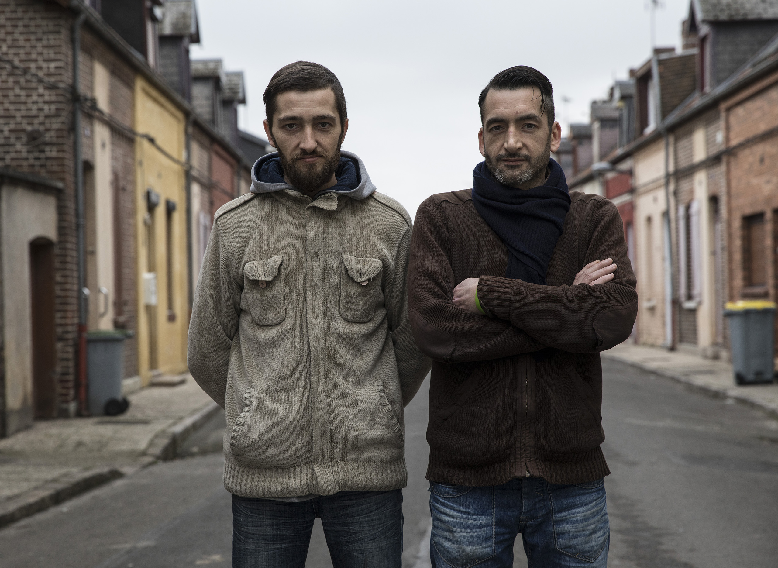 "Nicolas Pinto, 36, (left) and his brother David Pinto, 40 (right) in Saint-Ouen village, Somme next to Flixecourt, both looking for work.                                                                      Nicolas: ""The politicians all make empty promises. I would vote for Hollande again, he did the job. But never Le Pen. Our father was from Portugal, and she is anti-immigration. So for him I would not vote for her.""                                   David: ""We have to go 20 kilometers to find work. It is the fault of the EU. Everything is delocalized."""