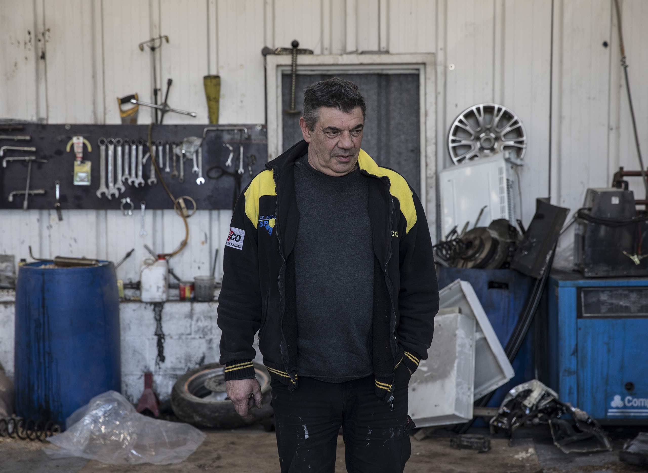 "Michael Vanwash, 59, owner of Saint Pierre autoshop in Amiens in northern France. ""The government is doing the maximum for refugees and we people who are French are grinding it out and we get nothing. That is why I like the National Front. There are many people who think like me but are embarrassed to say it."""