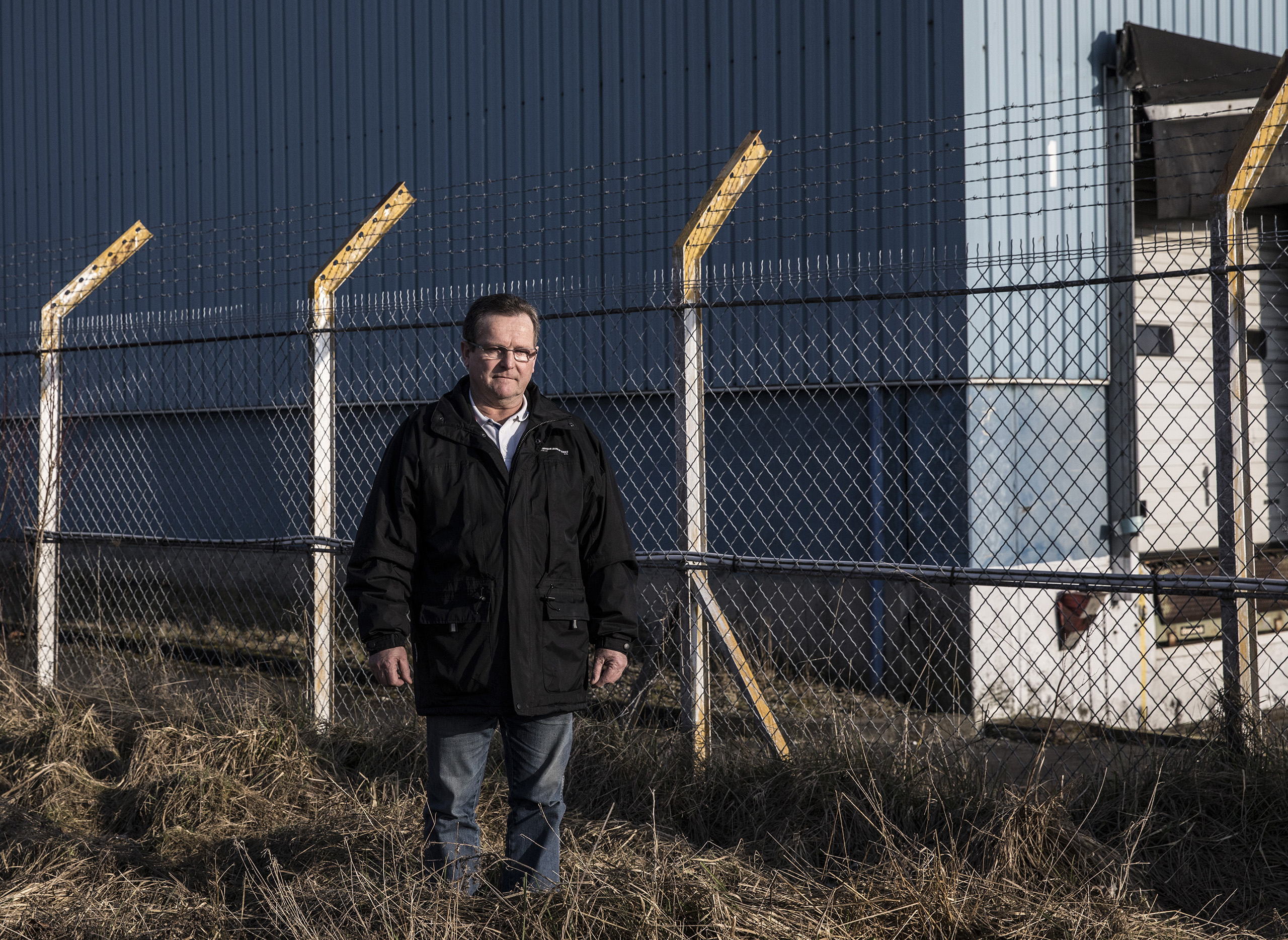 "Alain Dupuis, 64, former Goodyear worker in Amiens, until it closed in 2014 after a violent battle between activists and police. Now the mayor of the tiny village of Bourdon, he is standing in front of the now-deserted Goodyear plant. ""I am still thinking who to vote for. I have voted Socialist since 1981, but I've very disappointed with the left. More and more people in my village support Marine Le Pen. I think the National Front is still deeply racist.""                                                                                                         ."