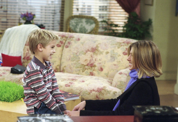 Cole Sprouse as Ben Geller and Jennifer Aniston as Rachel Green in Friends