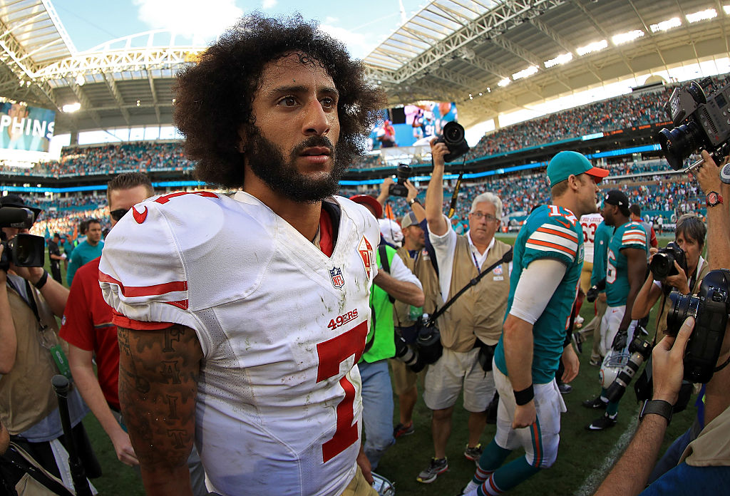 Colin Kaepernick #7 of the San Francisco 49ers looks on during a game against the Miami Dolphins on November 27, 2016 in Miami Gardens, Florida.