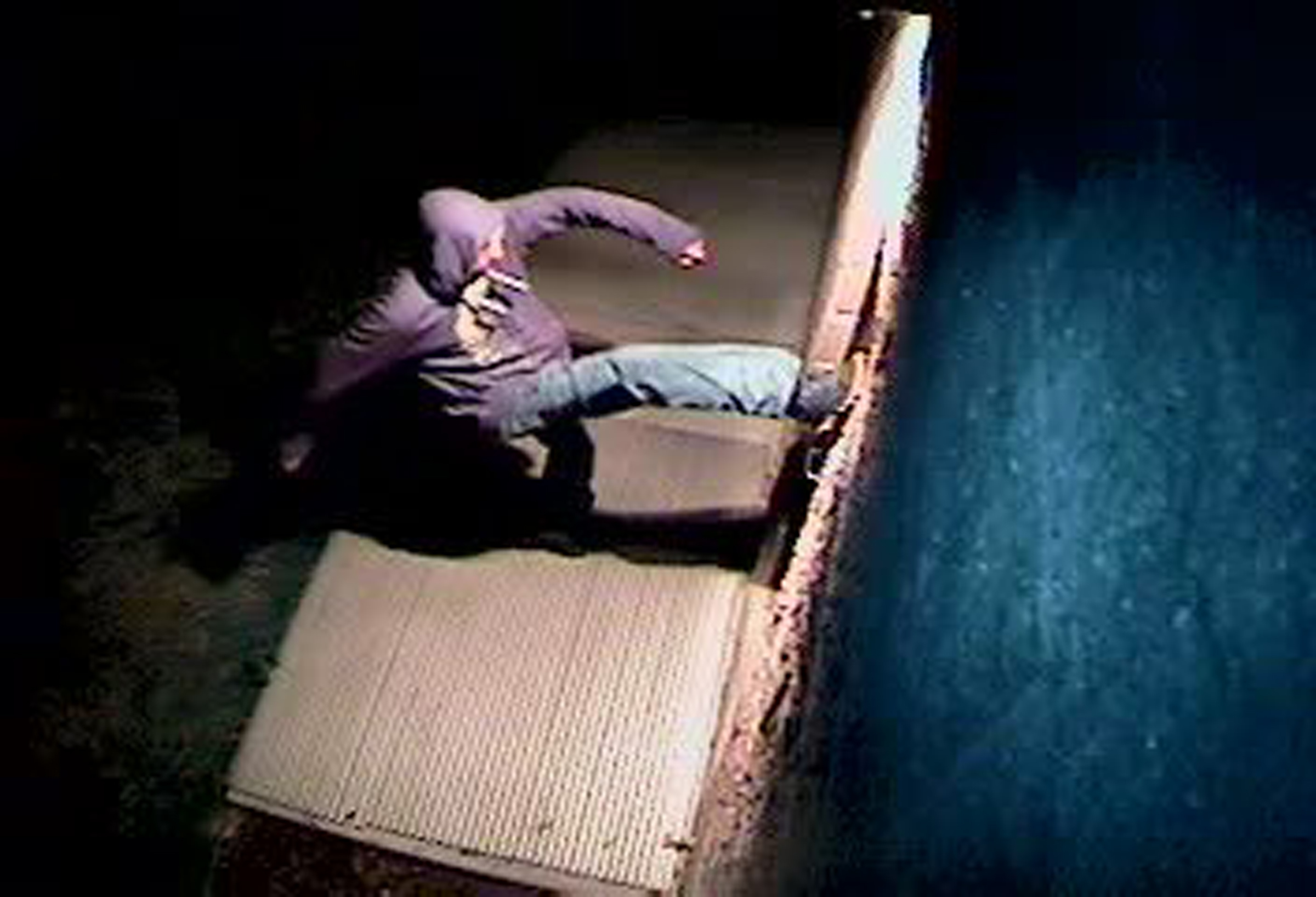In this Sunday, March 26, 2017, still image from a video surveillance camera, a suspect is shown during the vandalizing of a mosque near Colorado State University in Fort Collins, Colo.