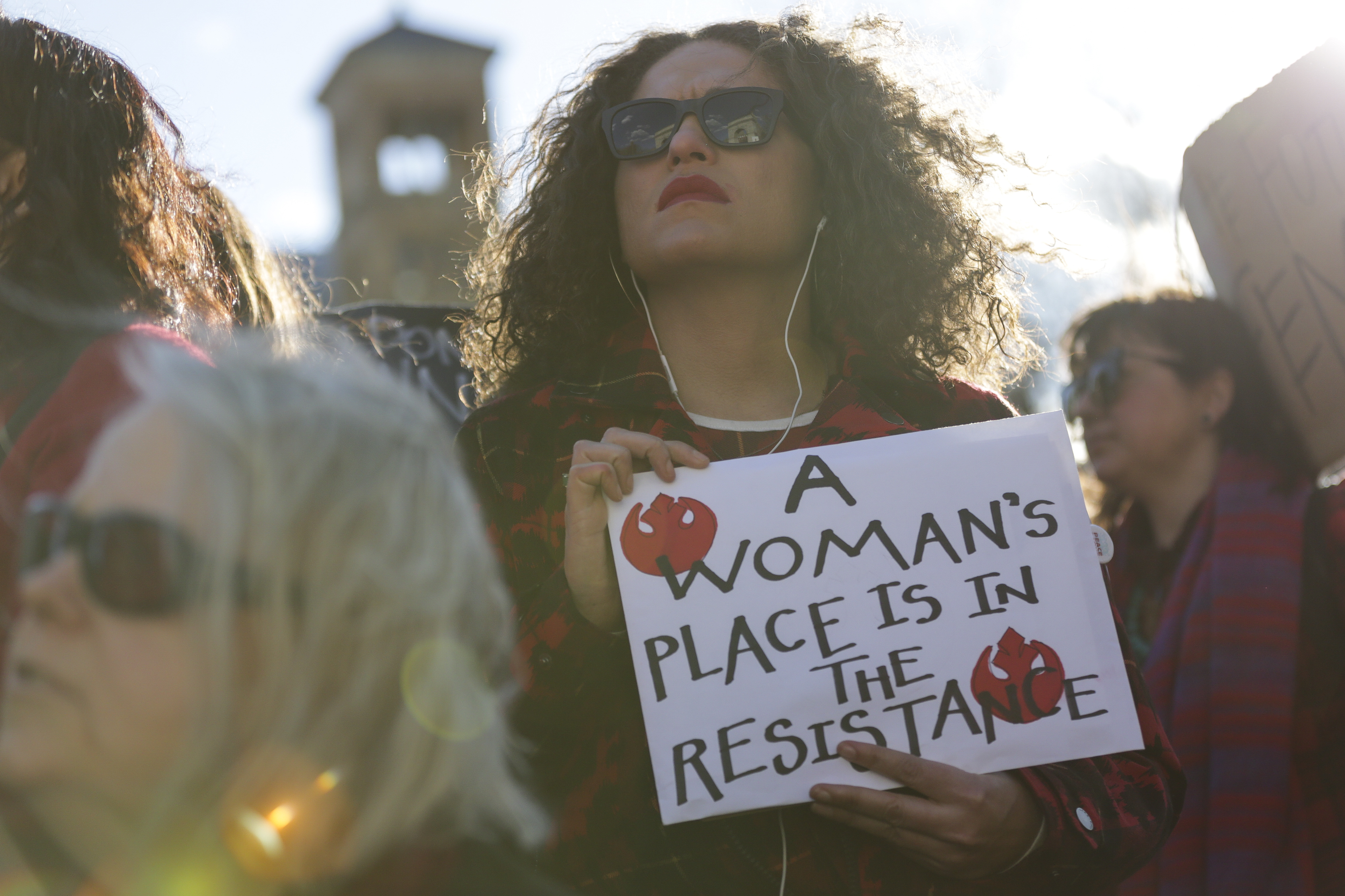 A demonstrator holds a sign while protesting during the Day Without a Woman strike at Washington Square Park in New York, U.S., on Wednesday, March 8, 2017. Some women stayed home from work, joined rallies or wore red to demonstrate their economic clout Wednesday in the U.S. as part of International Women's Day events held around the globe. The Day Without a Woman protest was put together by organizers of the vast women's marches that drew more than 1 million Americans into the streets the day after President Donald Trump's inauguration. Photographer: Jeenah Moon/Bloomberg via Getty Images