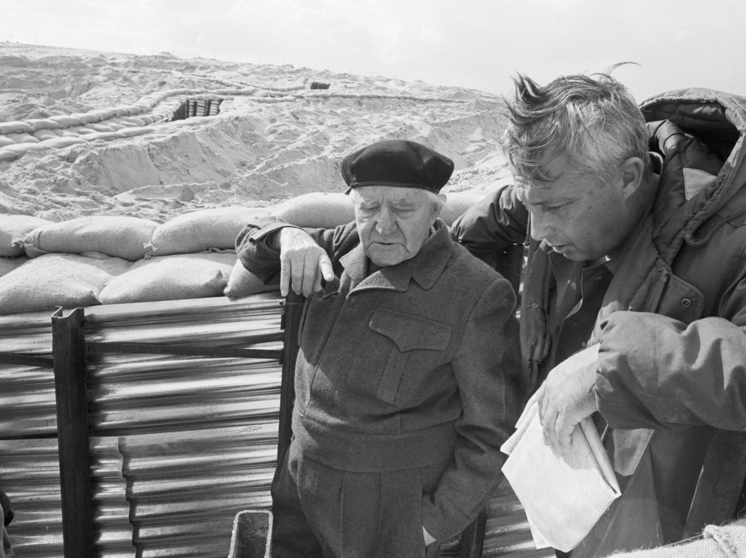 David Ben-Gurion, one of the architects of the Israeli state, with Ariel Sharon on the Israeli front lines at the Suez Canal during the War of Attrition, 1971.