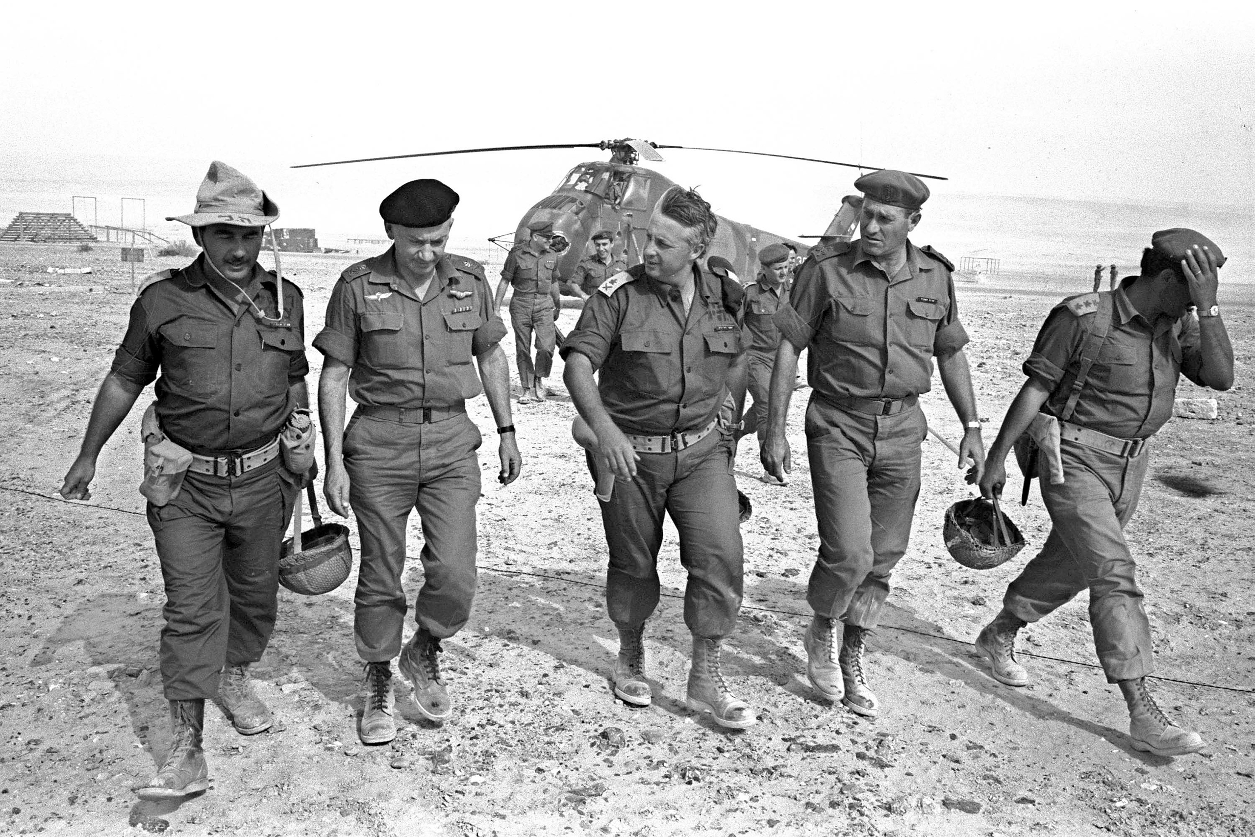 Israeli Army Gen. Ariel Sharon (C), flanked by Gens. Haim Bar-Lev (L) and Yishayahu Gavish (R) and unidentified aides, arrives by helicopter at an army base in Israel's Negev Desert, June 1, 1967.