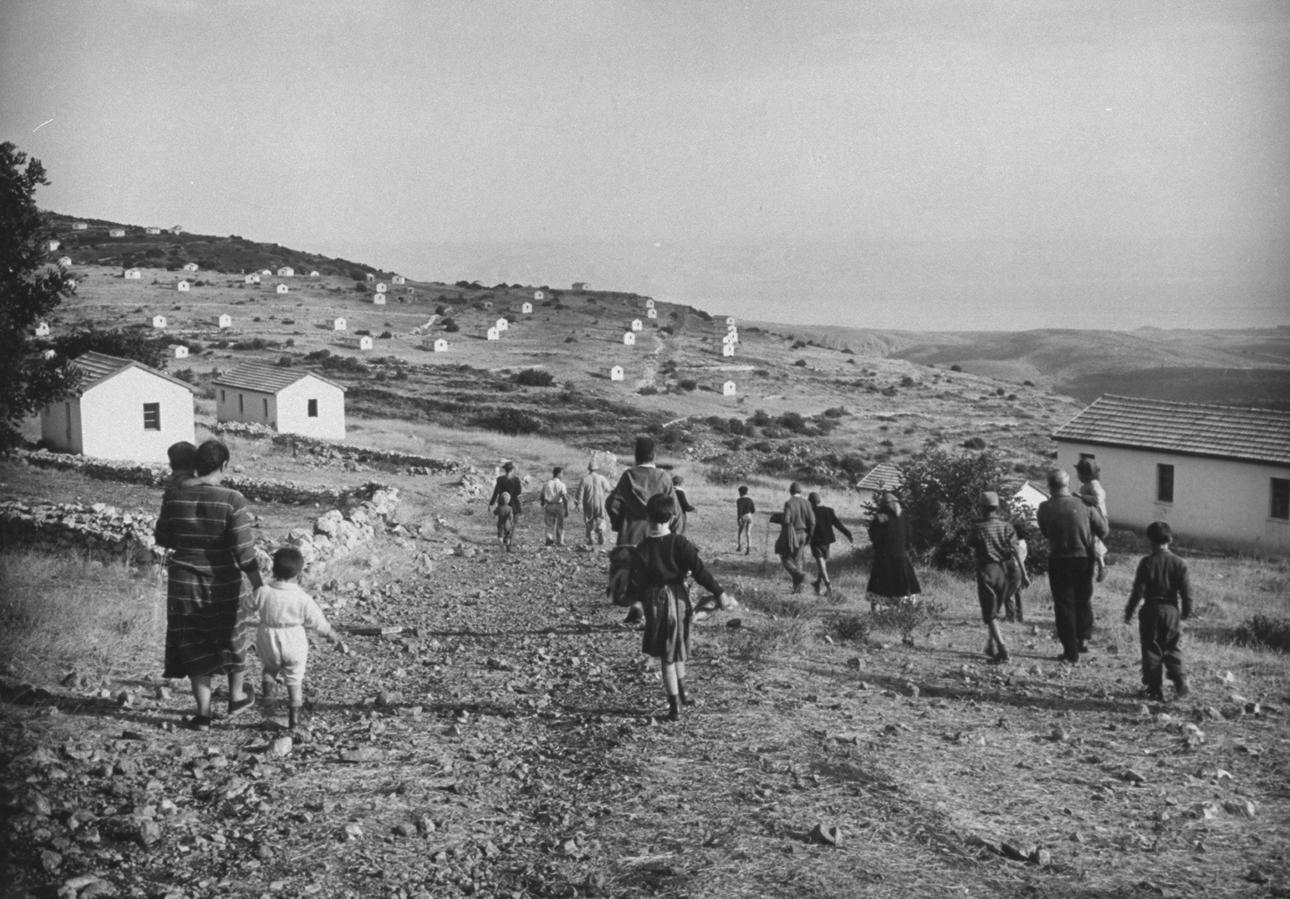 Jewish settlers walking through hilly region above Lake Galilee, 1954.