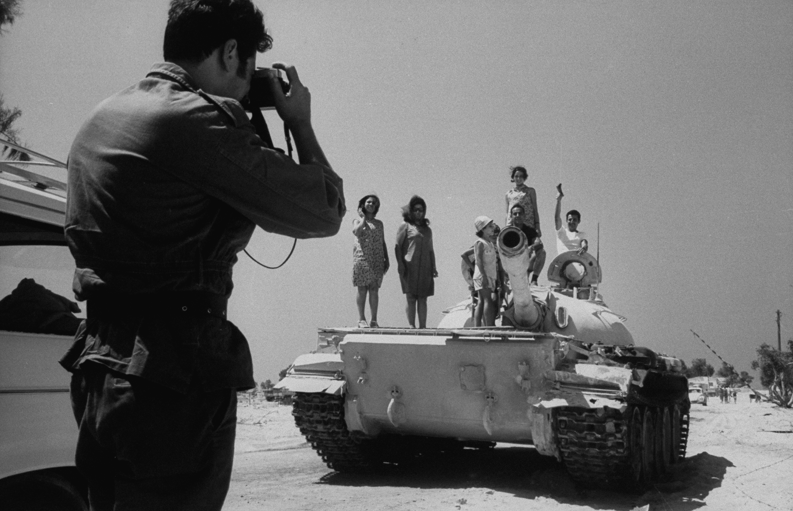 Israeli tourists inspecting captured Egyptian weapons, on their visit to Gaza after the war, 1967.