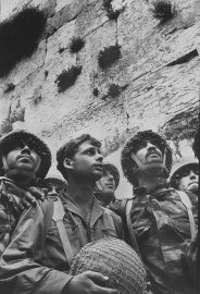 Small group of Israeli soldiers at the wailing wall after it was recaptured during the 1967 war.