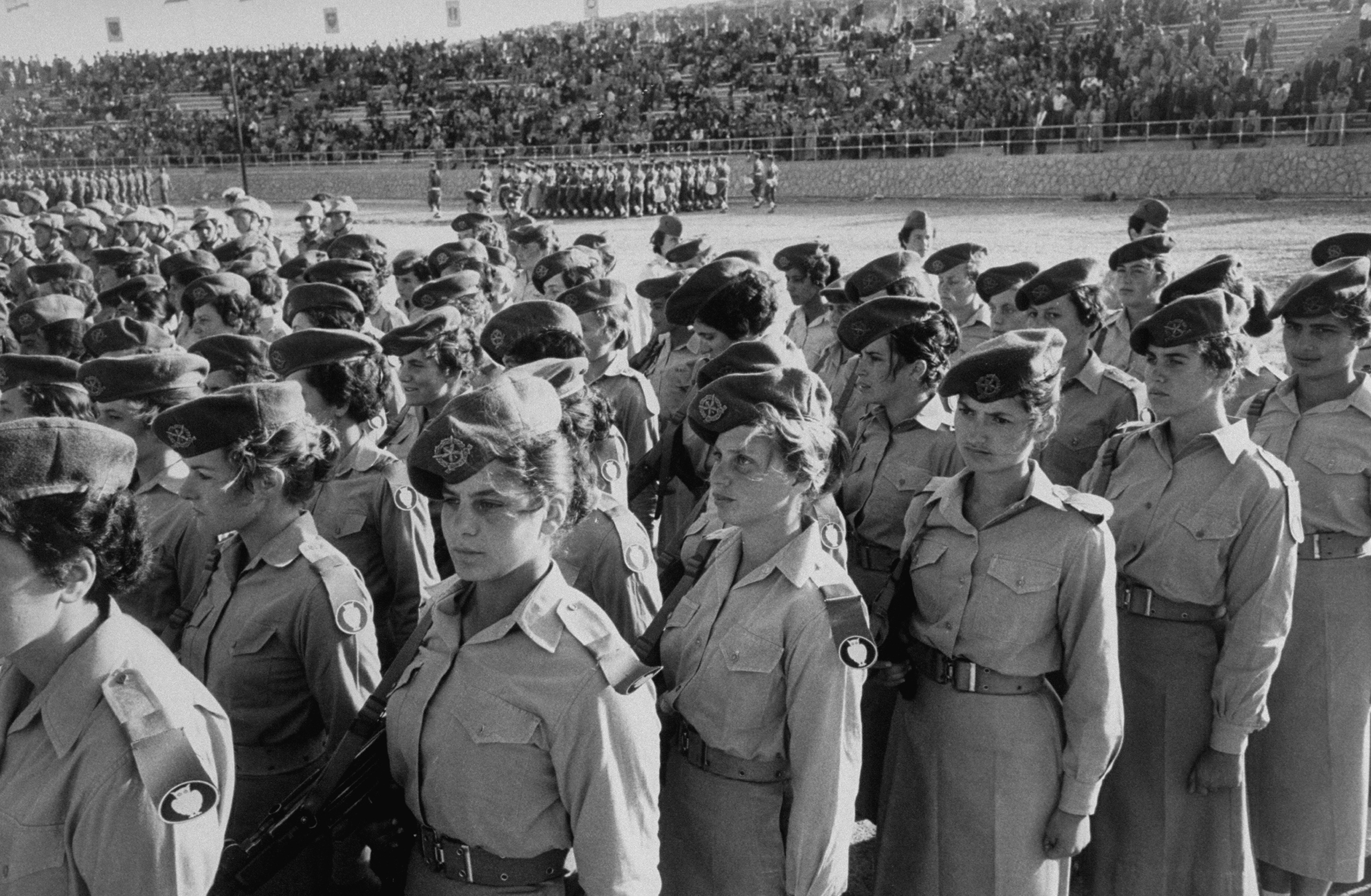 Israeli women's Army unit parading in Jerusalem carrying burp guns, on the 10th anniversary of Israeli nationhood,1956.