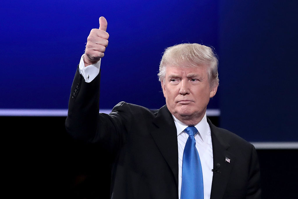 Republican presidential nominee Donald Trump waves after the Presidential Debate with Democratic presidential nominee Hillary Clinton at Hofstra University on September 26, 2016 in Hempstead, New York.