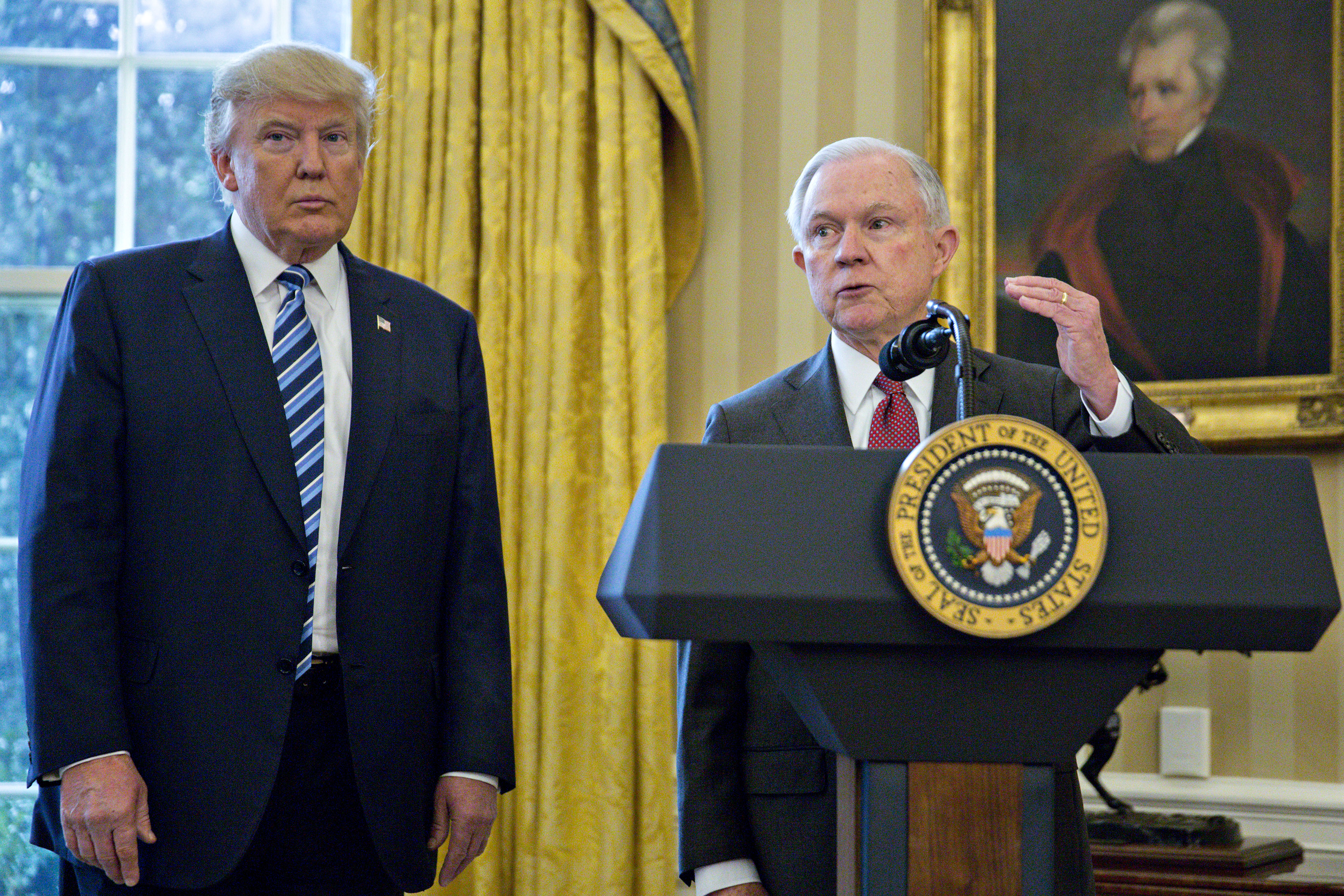 Jeff Sessions, U.S. attorney general, speaks as U.S. President Donald Trump, left, listens after Sessions was sworn in by U.S. Vice President Mike Pence, not pictured, in the Oval Office of the White House in Washington, D.C., U.S., on Thursday, Feb. 9, 2017.