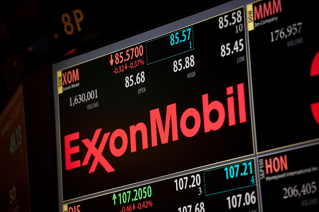 A monitor displays Exxon Mobil Corp. signage on the floor of the New York Stock Exchange (NYSE) in New York, U.S., on Monday, Jan. 23, 2017.