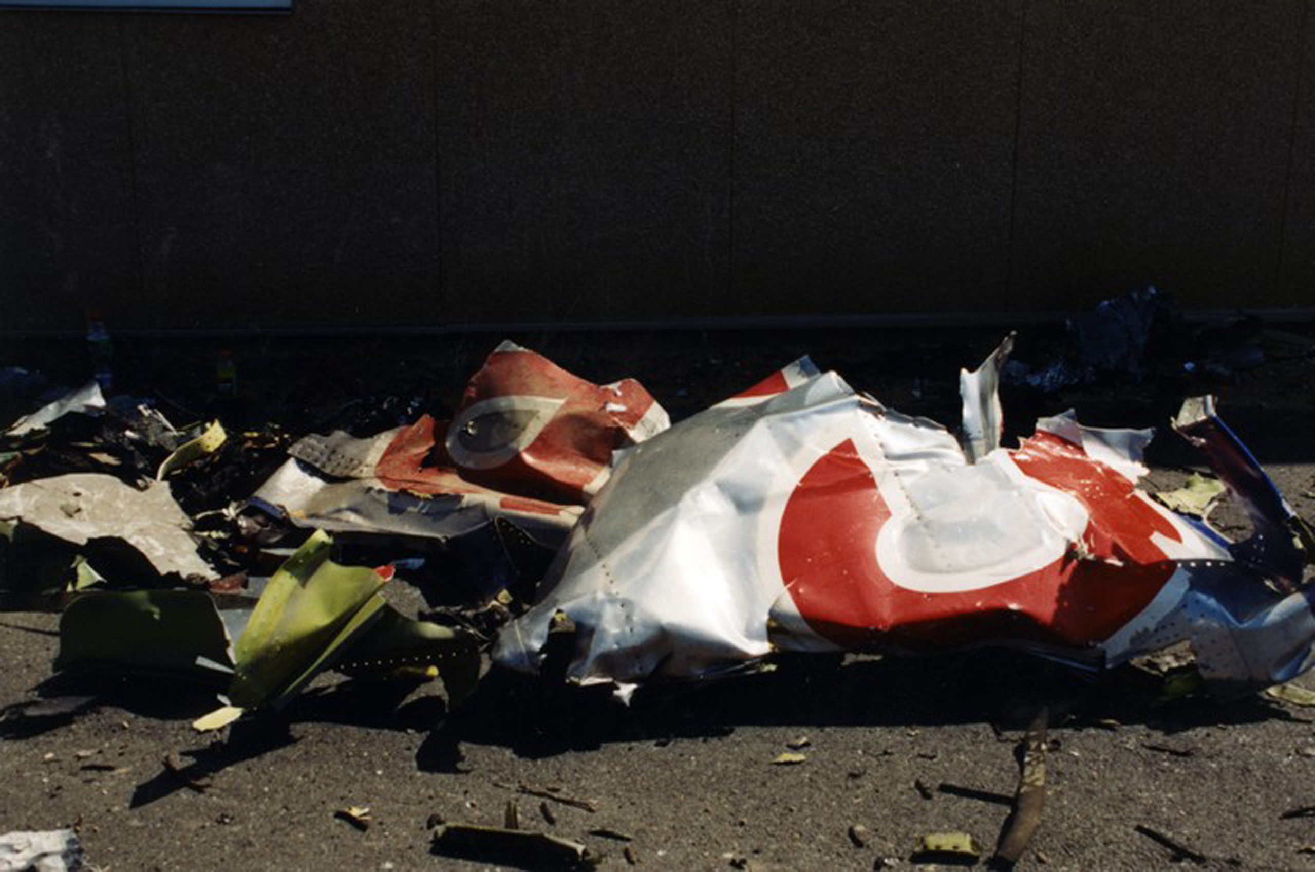 Debris lays on the ground after the hijacked American Airlines Flight 77 crashed into the Pentagon in Arlington County, Virginia, on Sept. 11, 2001.