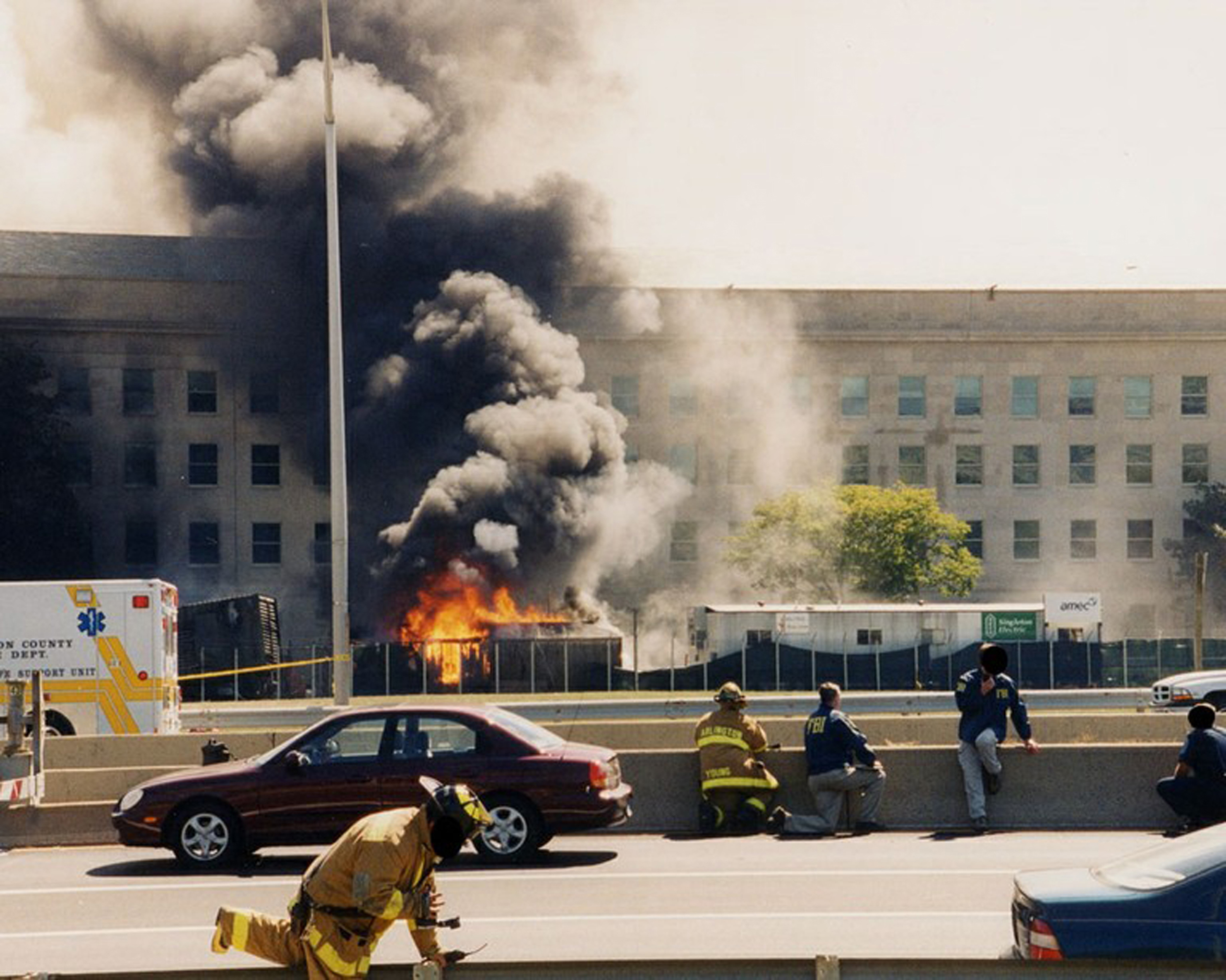 Flames and smoke billowing from a hole in the exterior wall after the hijacked American Airlines Flight 77 crashed into the Pentagon in Arlington County, Virginia, on Sept. 11, 2001.