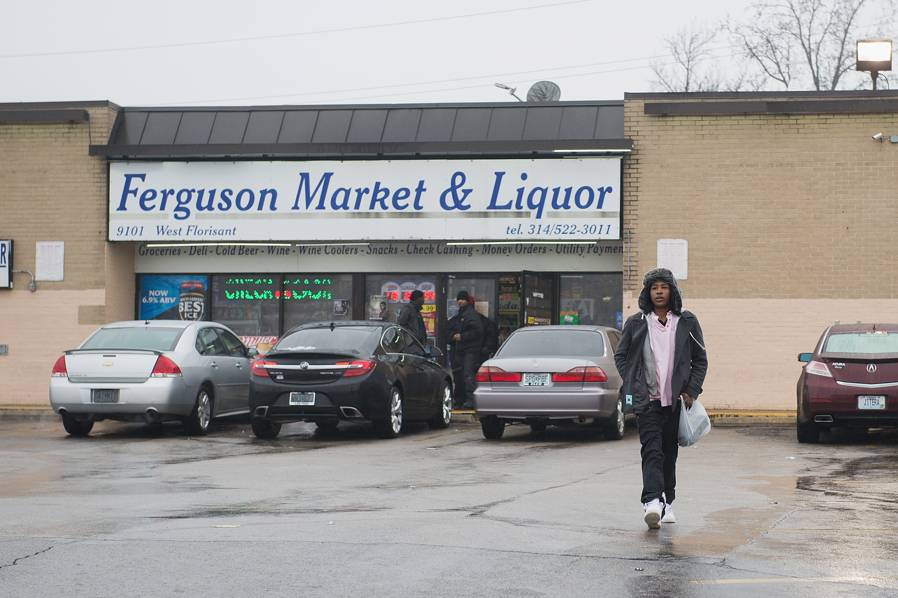 A woman walks outside the Ferguson Market and Liquor on March 13, 2017 in Ferguson, Missouri as tensions visit the city following video footage of slain 18 year-old Michael Brown in a recent documentary.