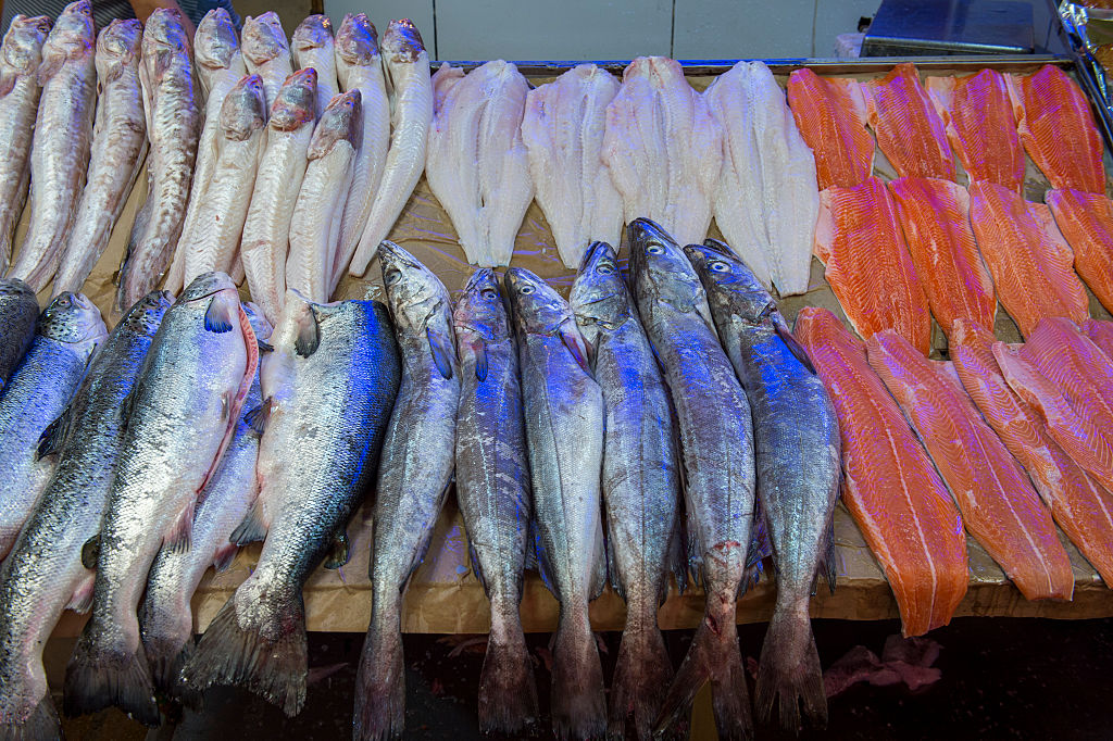 Market scene with fresh fish for sale in the market hall in Angelmo, Puerto Montt in southern Chile.