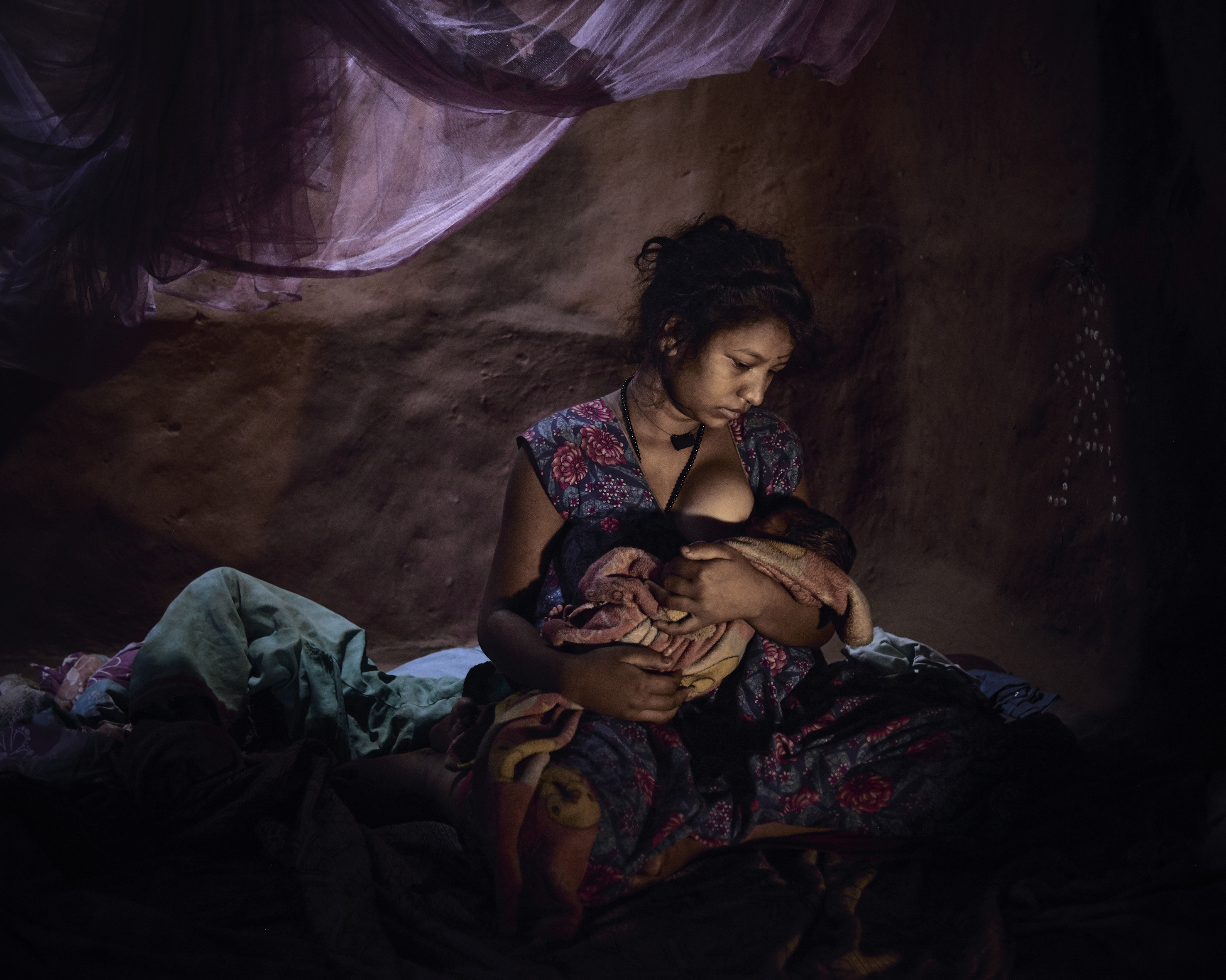 Saraswati, 16, must live in a closed dark room with her baby because she bled after childbirth.