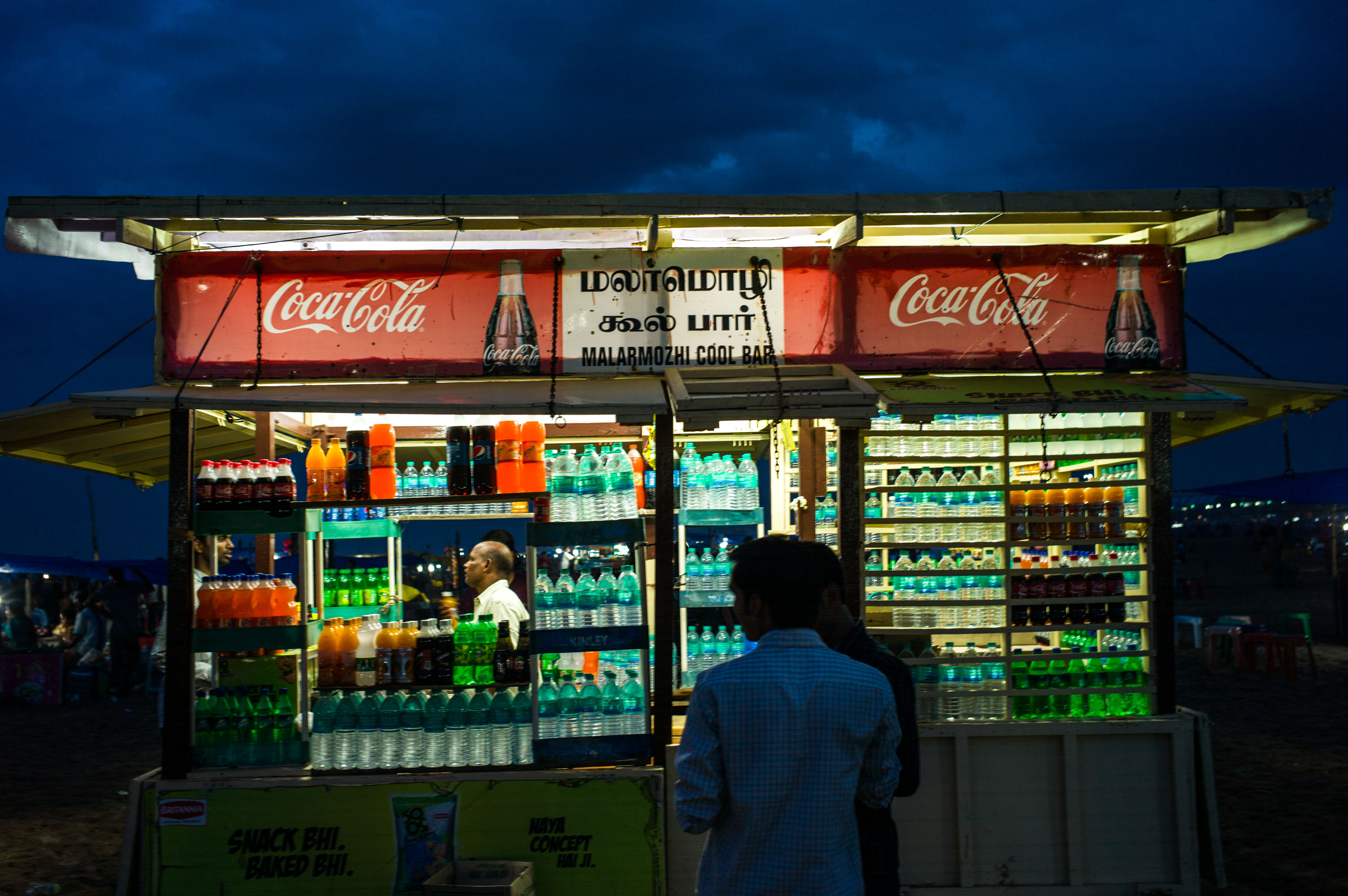 A vendor sells water and bottled drinks on Marina Beach in Chennai, Tamil Nadu, India, on July 20, 2014.