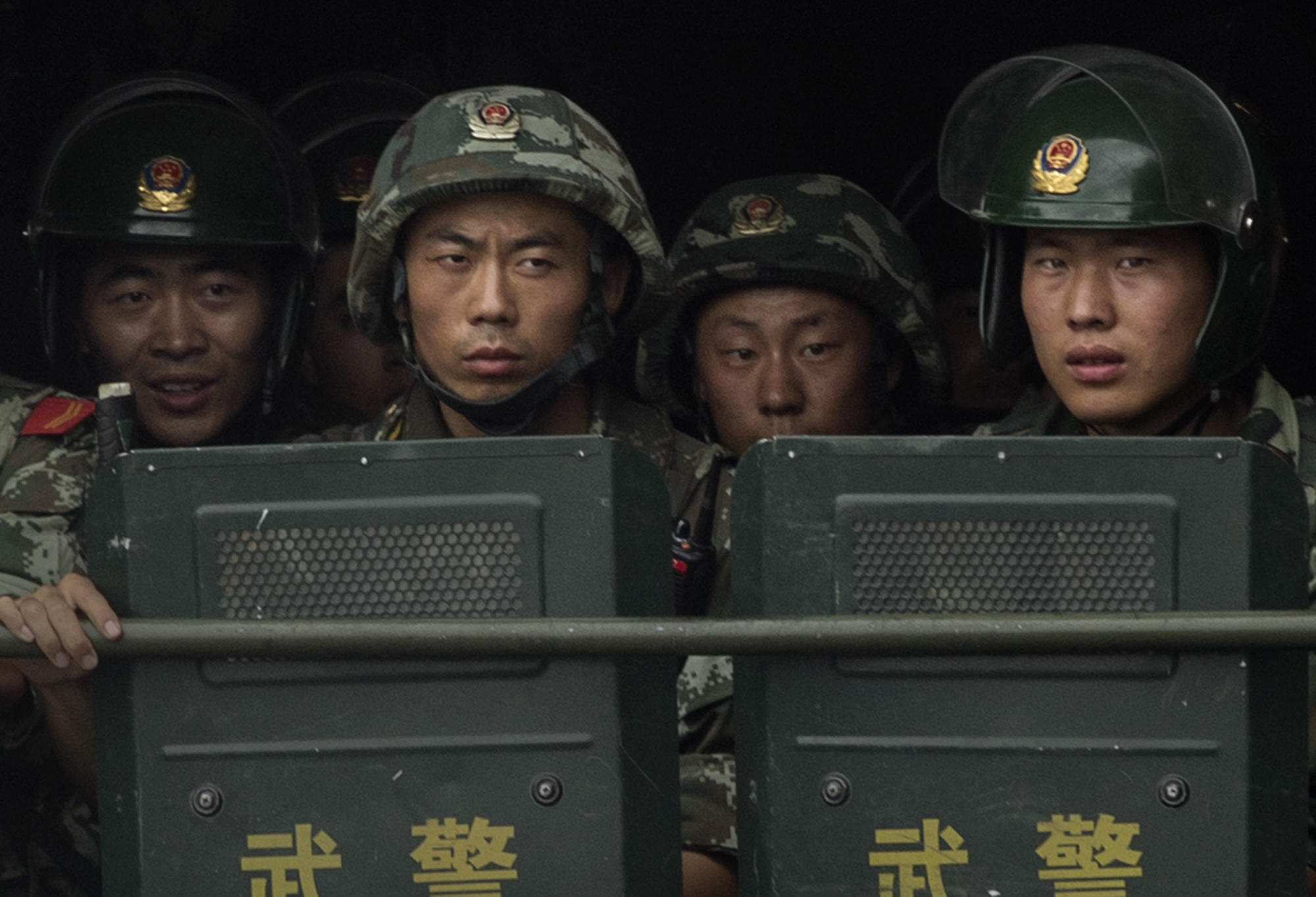 Chinese soldiers ride on the back of a truck as they patrol outside the Id Kah Mosque, China's largest, on July 31, 2014 in Kashgar, China.