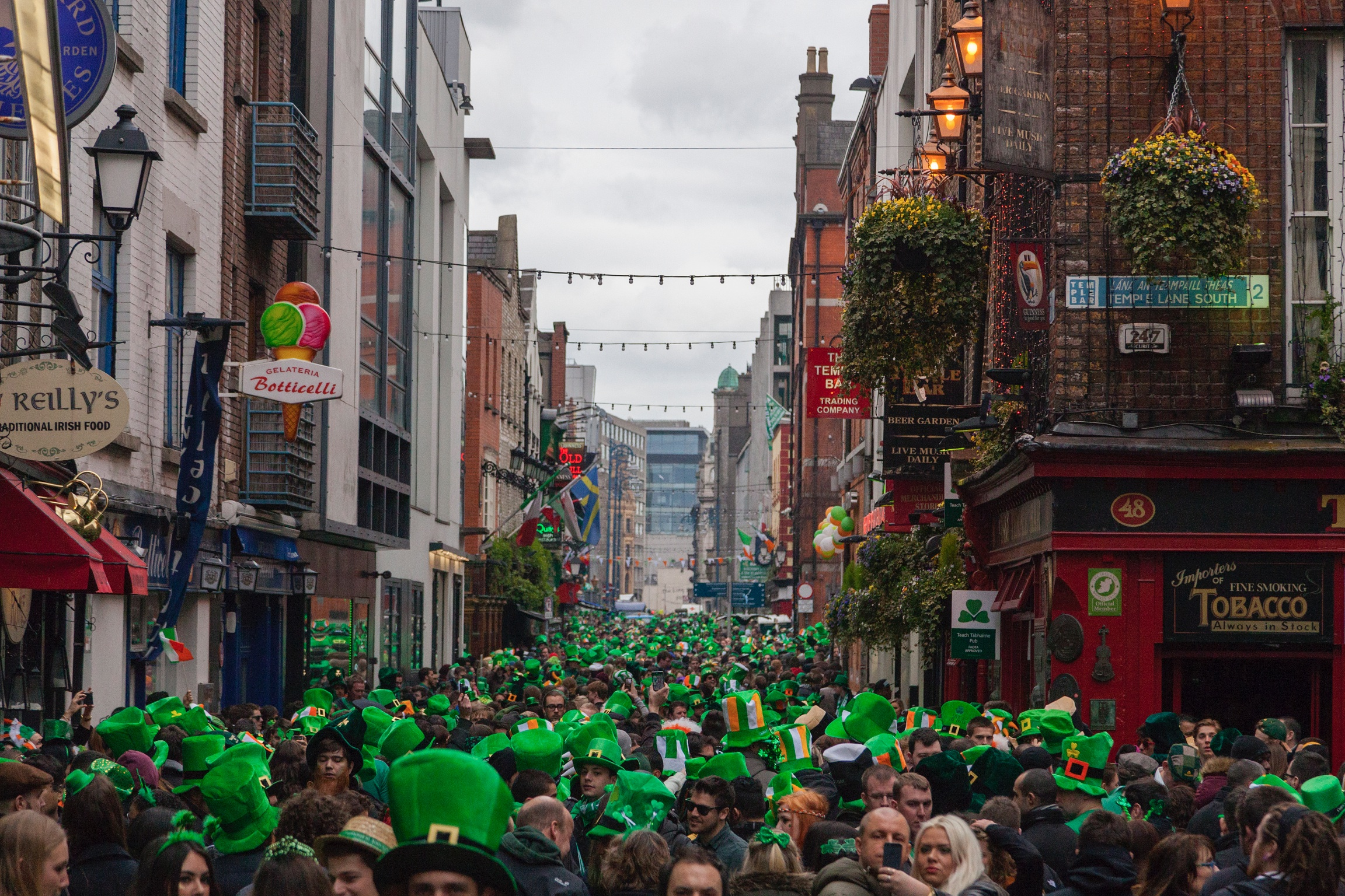 Image of the crowds gathered in Temple Bar after St. Patrick's day parade in Dublin, Ireland.