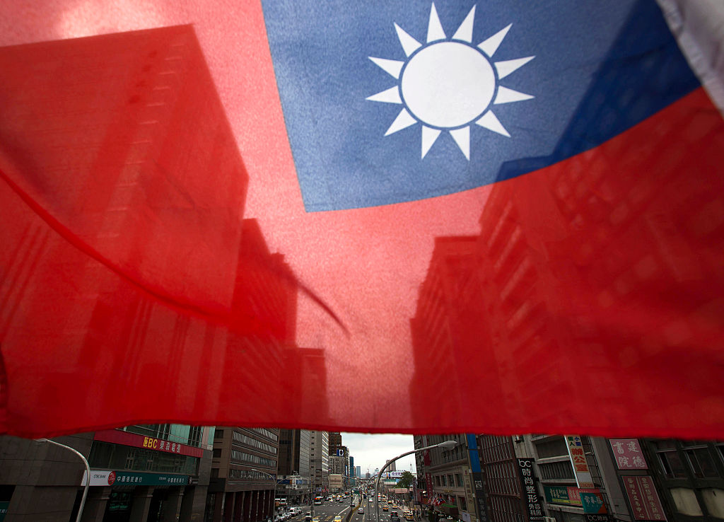 A Taiwanese flag flies in front of buildings in Taipei, Taiwan, on Nov. 9, 2015.
