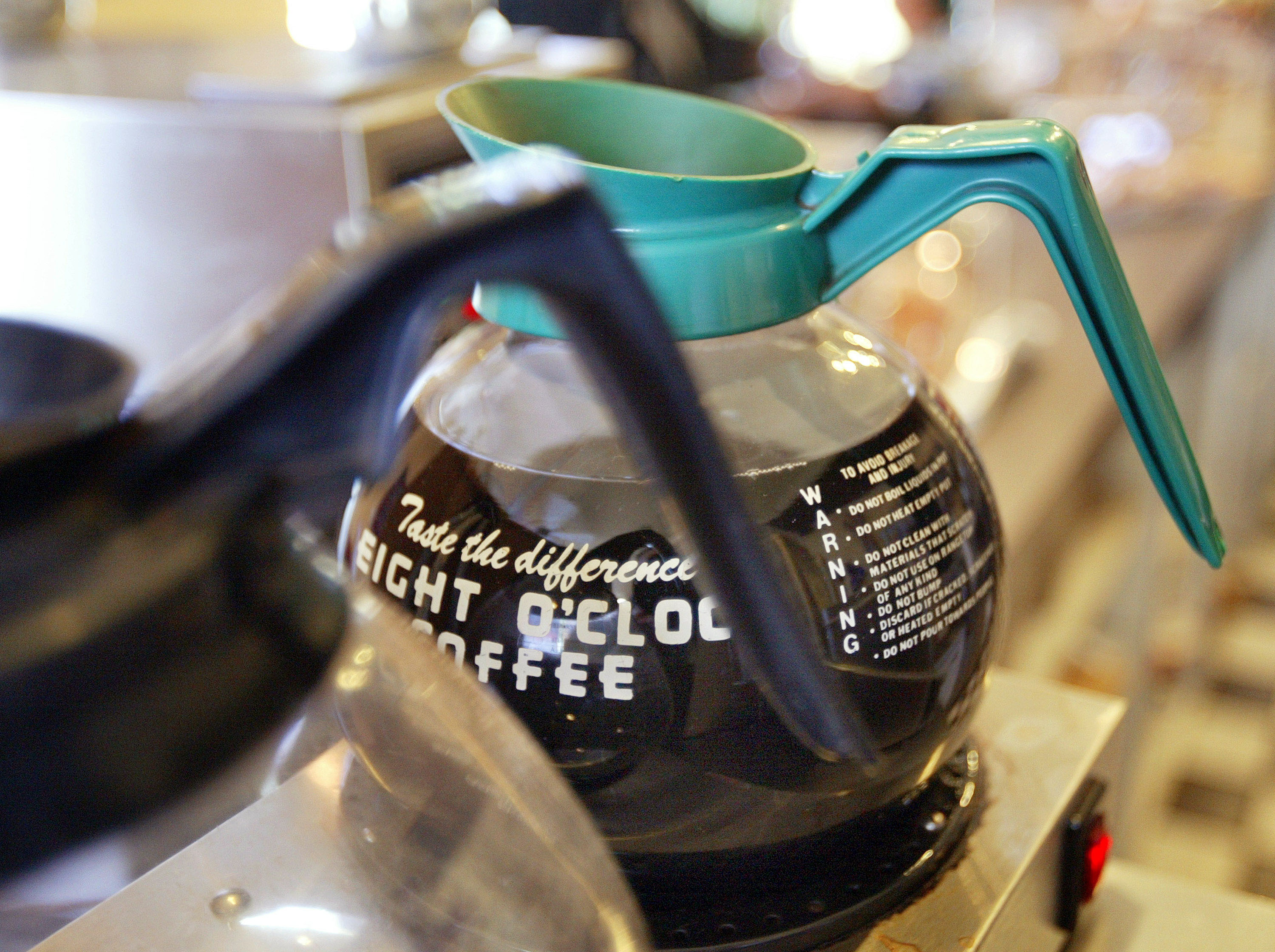 Coffee pots are seen on the counter of the Cafe Express coffee house October 1, 2004 in Evanston, Illinois.