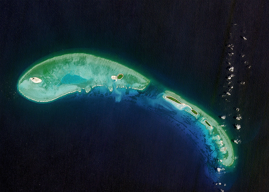 A satellite image of North Island trailed by some smaller islands. Part of the Paracel Islands in the South China Sea, April 11 2016.