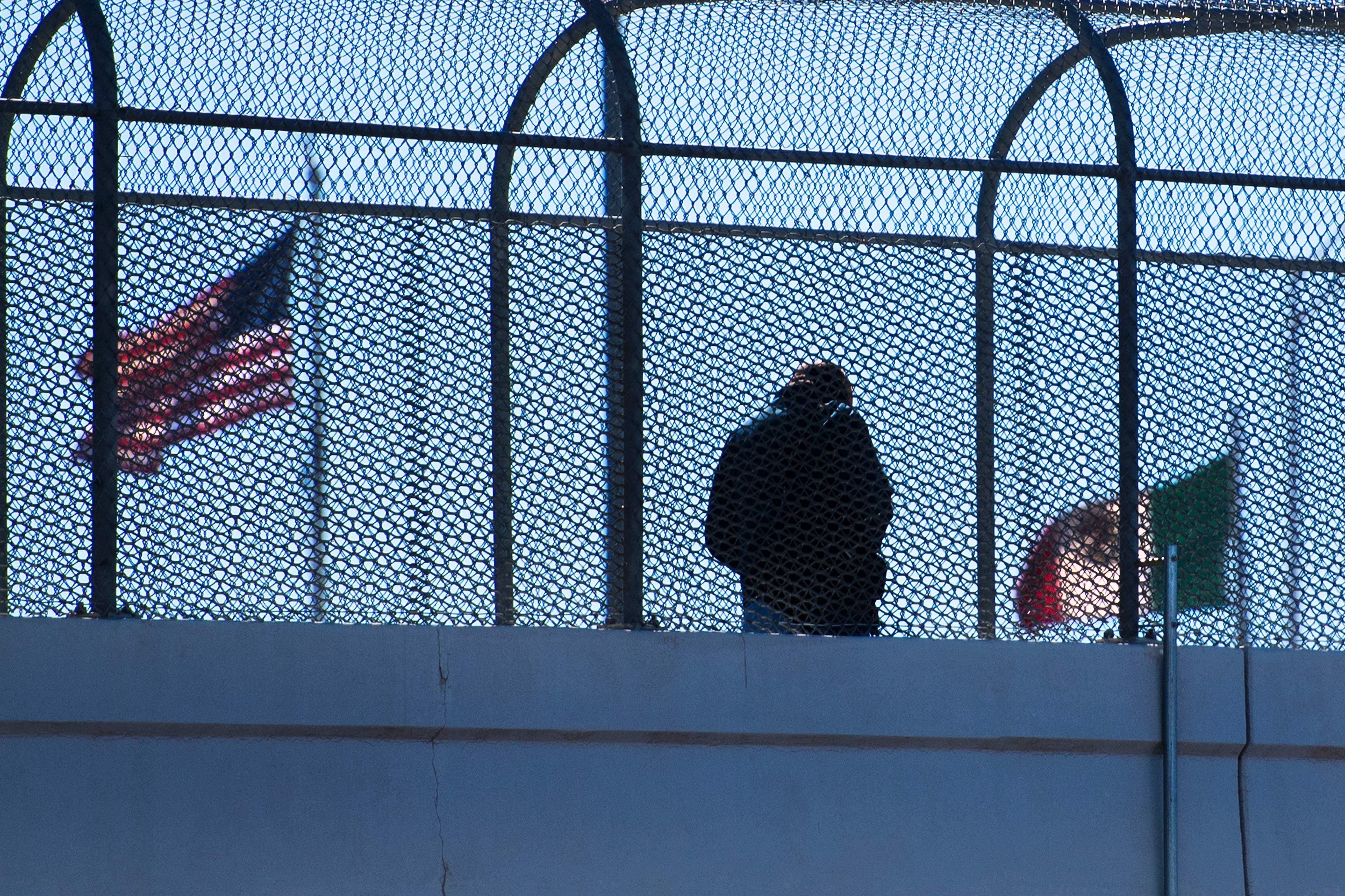 A man crosses the footbridge to Juarez, Mexico, from El Paso, Texas, on February 20, 2017.
