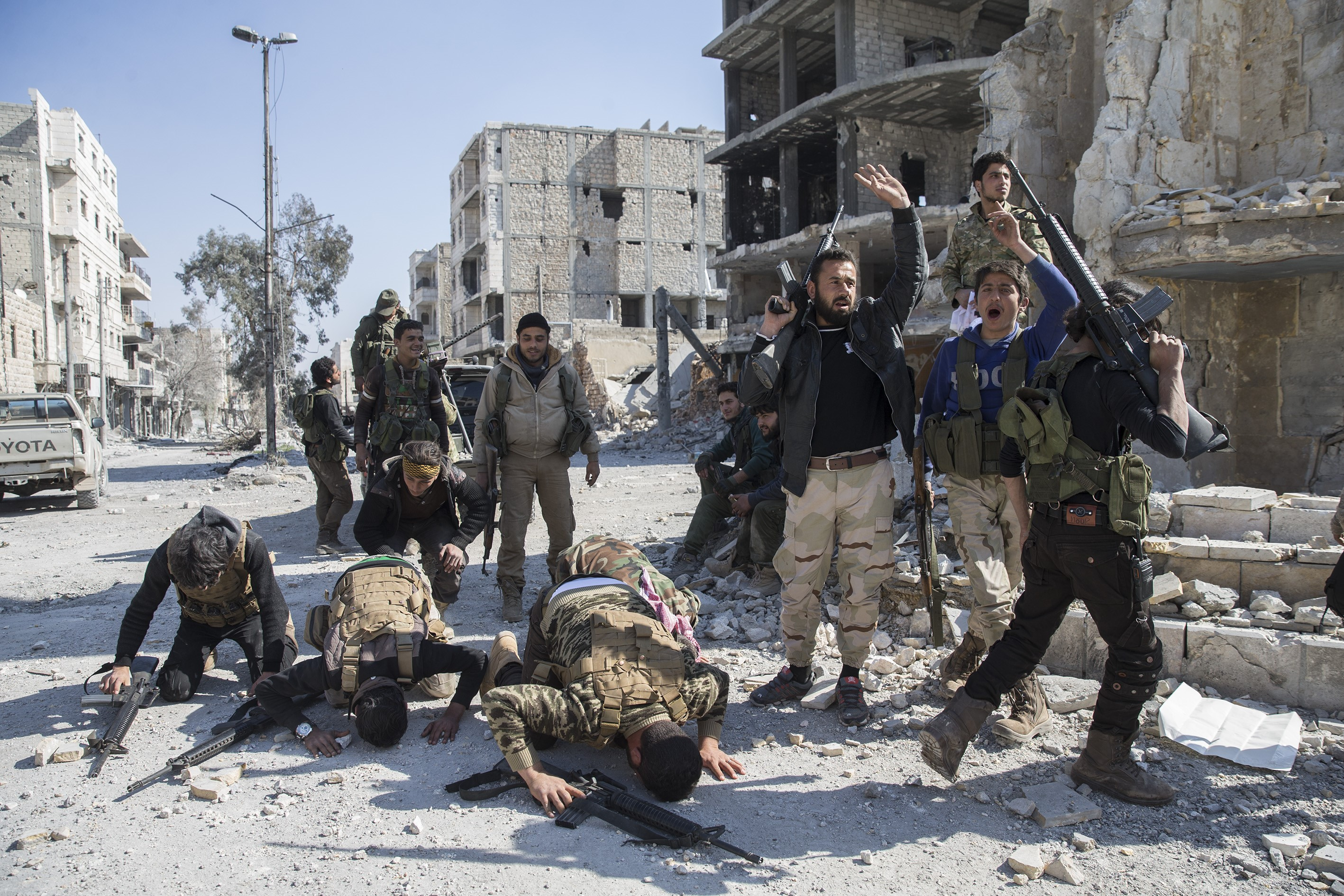 Members of Free Syrian Army celebrate in Syria's Al Bab, after taking control of the district from Daesh during  Operation Euphrates Shield , Aleppo, Syria on Feb. 23, 2017.